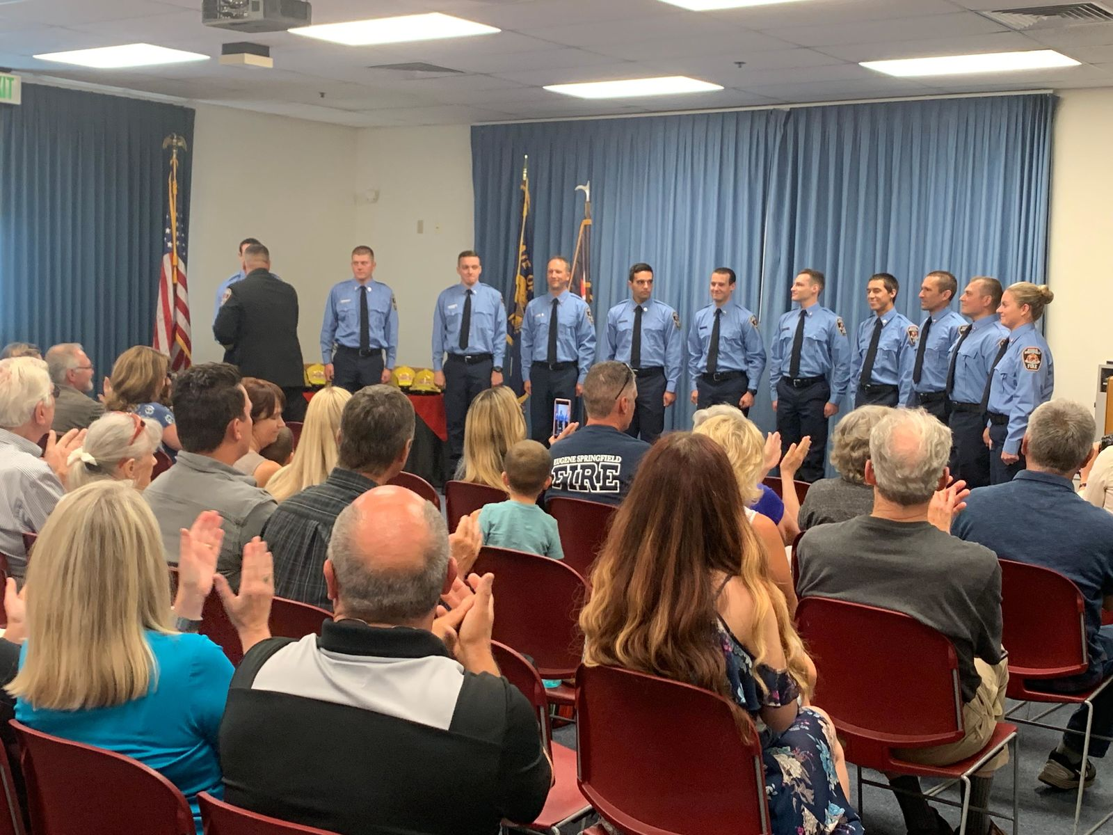 11 new firefighters received their badge and helmet, graduating as Eugene Springfield Fire Department recruits, July 12, 219. (SBG)