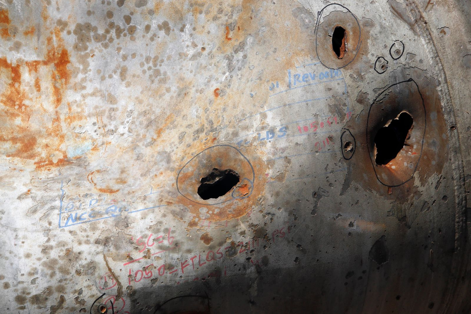 In this photo opportunity during a trip organized by Saudi information ministry, holes caused by fragments of a missile are seen in a damaged pipe in the Aramco's Khurais oil field, Saudi Arabia, Friday, Sept. 20, 2019, after it was hit during Sept. 14 attack. (AP Photo/Amr Nabil)