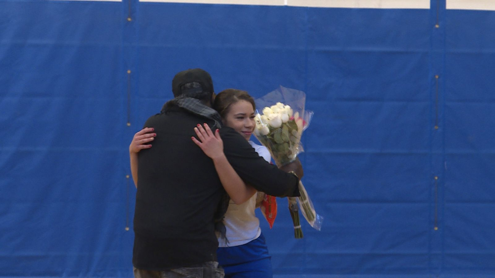 Nevaeh and Rodney hugging at Grants Pass High School. (Carsyn Currier/News 10){ }