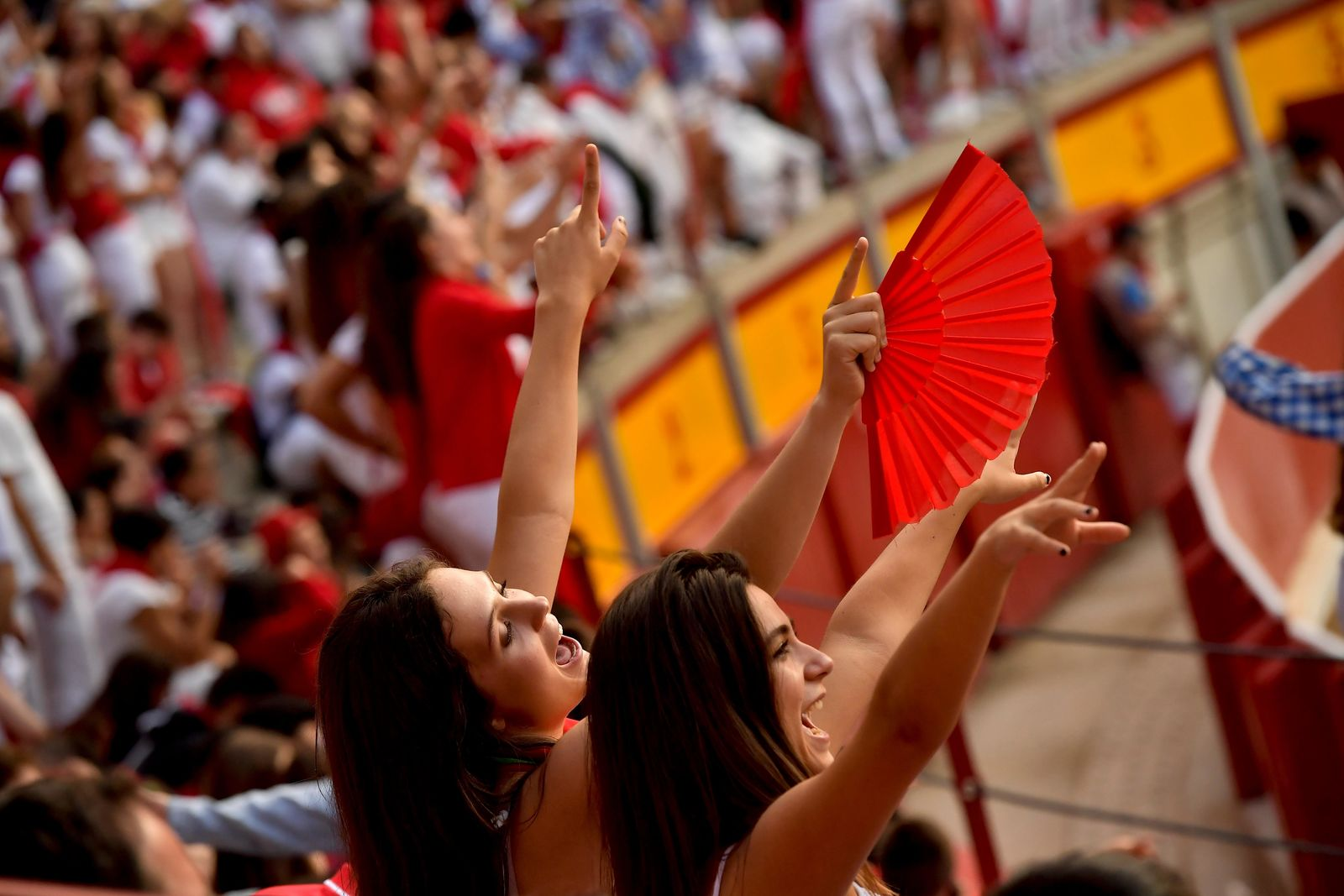 "Revellers wait for the arrival of the fighting bulls at the bullring during the San Fermin Festival, in Pamplona, northern Spain, Sunday, July 14, 2019. The San Fermin fiesta made internationally famous by Ernest Hemingway in his novel ""The Sun Also Rises"" draws around 1 million partygoers each year.(AP Photo/Alvaro Barrientos)"