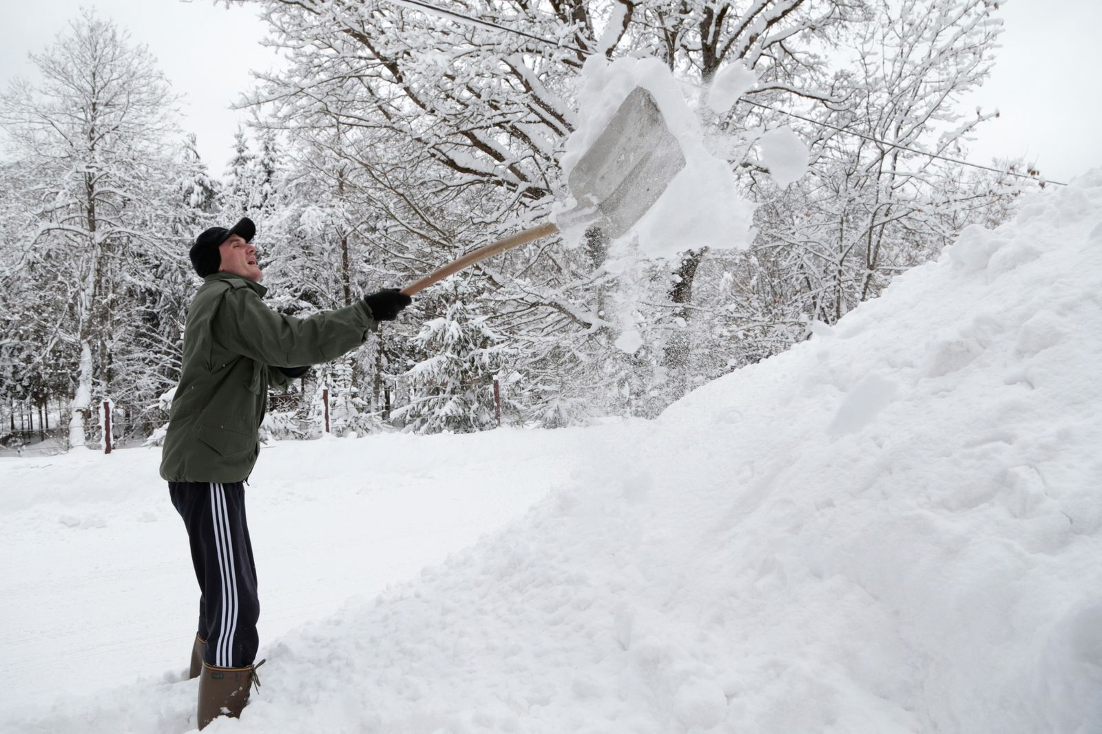 A man shovels snow in front of his house in a remote village near Kladanj, 80 kms north of Sarajevo, Bosnia, Friday, Jan. 11. (AP Photo/Amel Emric)