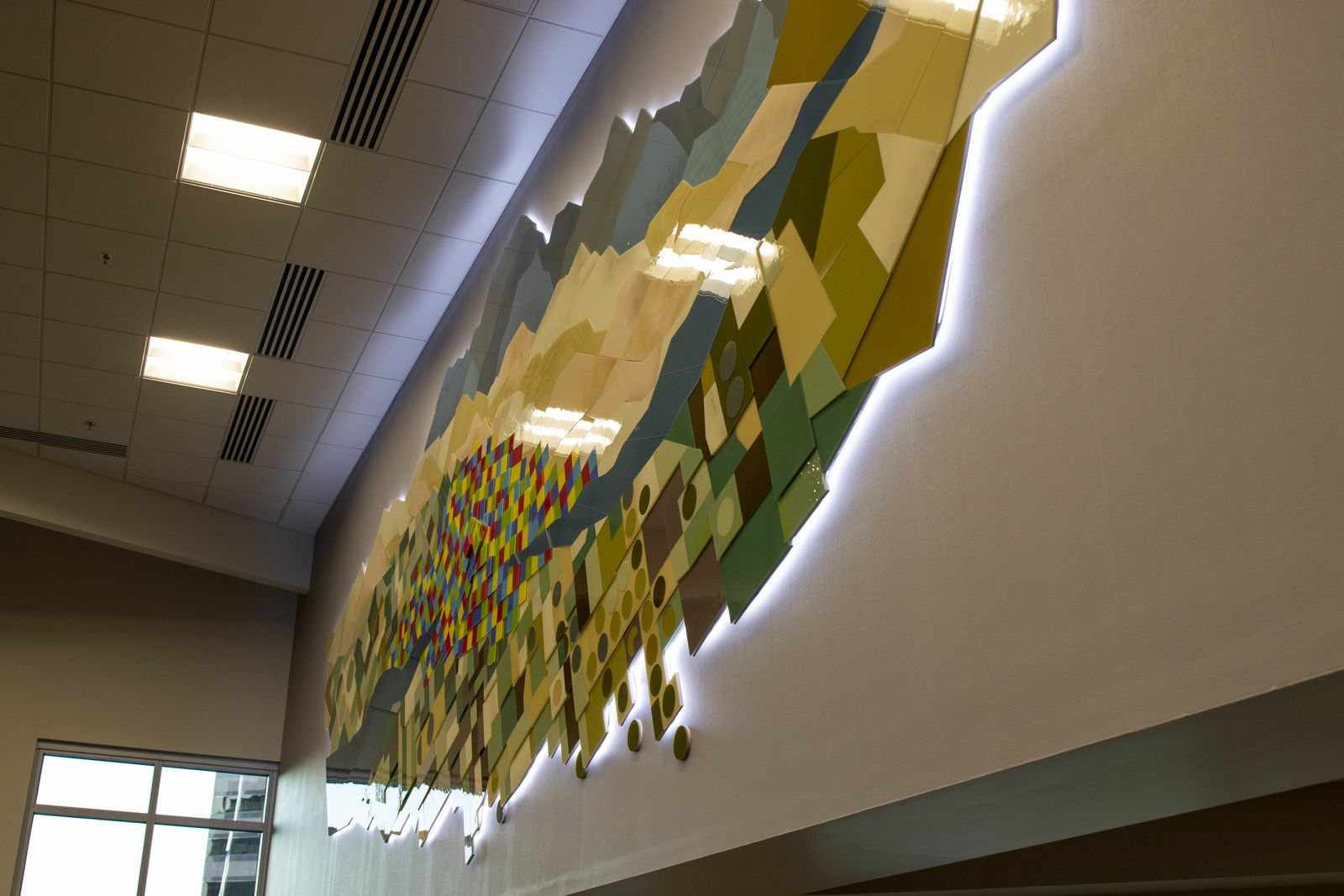 The Boise Centre got a new look Thursday with the dedication of new glass sculpture. The installation is located in Centre East and is made out of hundreds of stained glass pieces. (Photos by Axel Quartarone){ }{ }