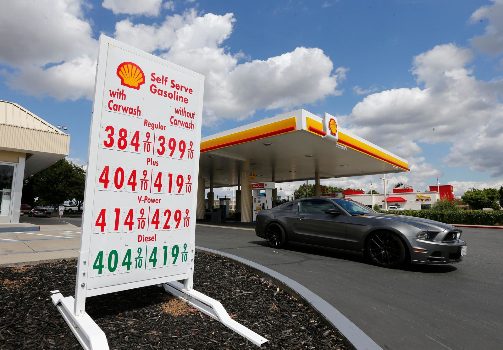 In this photo taken Friday, May 17, 2019, a car leaves a Shell station after getting gas in Sacramento, Calif. California's gas prices are set to climb July 1 when the state's gas tax climbs another 5.6 cents a gallon. The rise in the gas tax is just one of the new laws taking effect July 1. (AP Photo/Rich Pedroncelli)