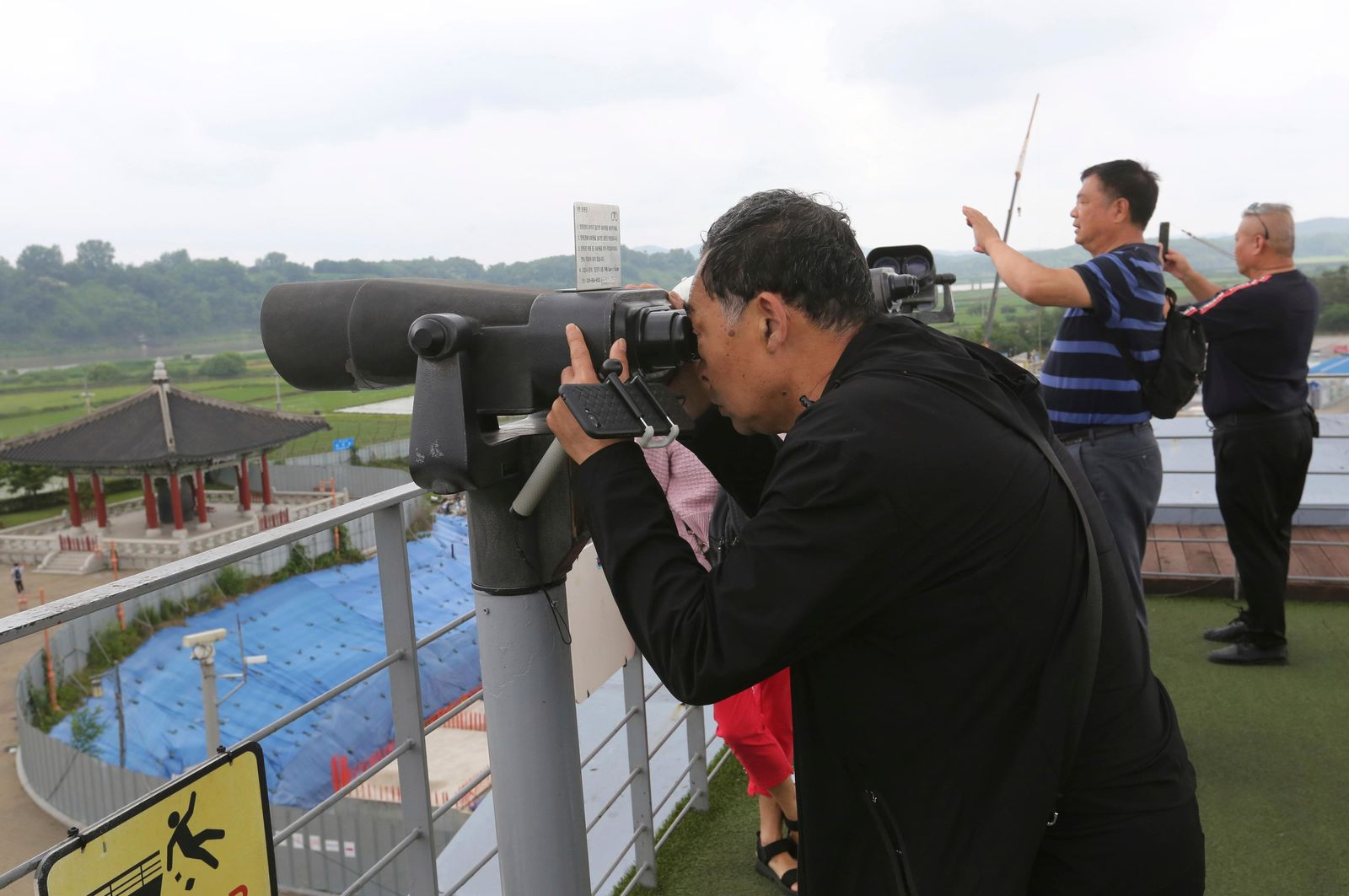 Chinese visitors look toward the North's side at the Imjingak Pavilion, near the demilitarized zone of Panmunjom, in Paju, South Korea, Thursday, June 20, 2019.{ } (AP Photo/Ahn Young-joon)