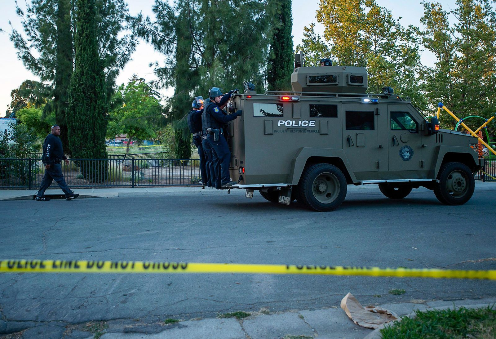 Sacramento police officers respond to a shooting on Redwood Avenue in the Noralto neighborhood, Wednesday, June 19, 2019, in Sacramento, Calif. (Paul Kitagaki Jr./The Sacramento Bee via AP)