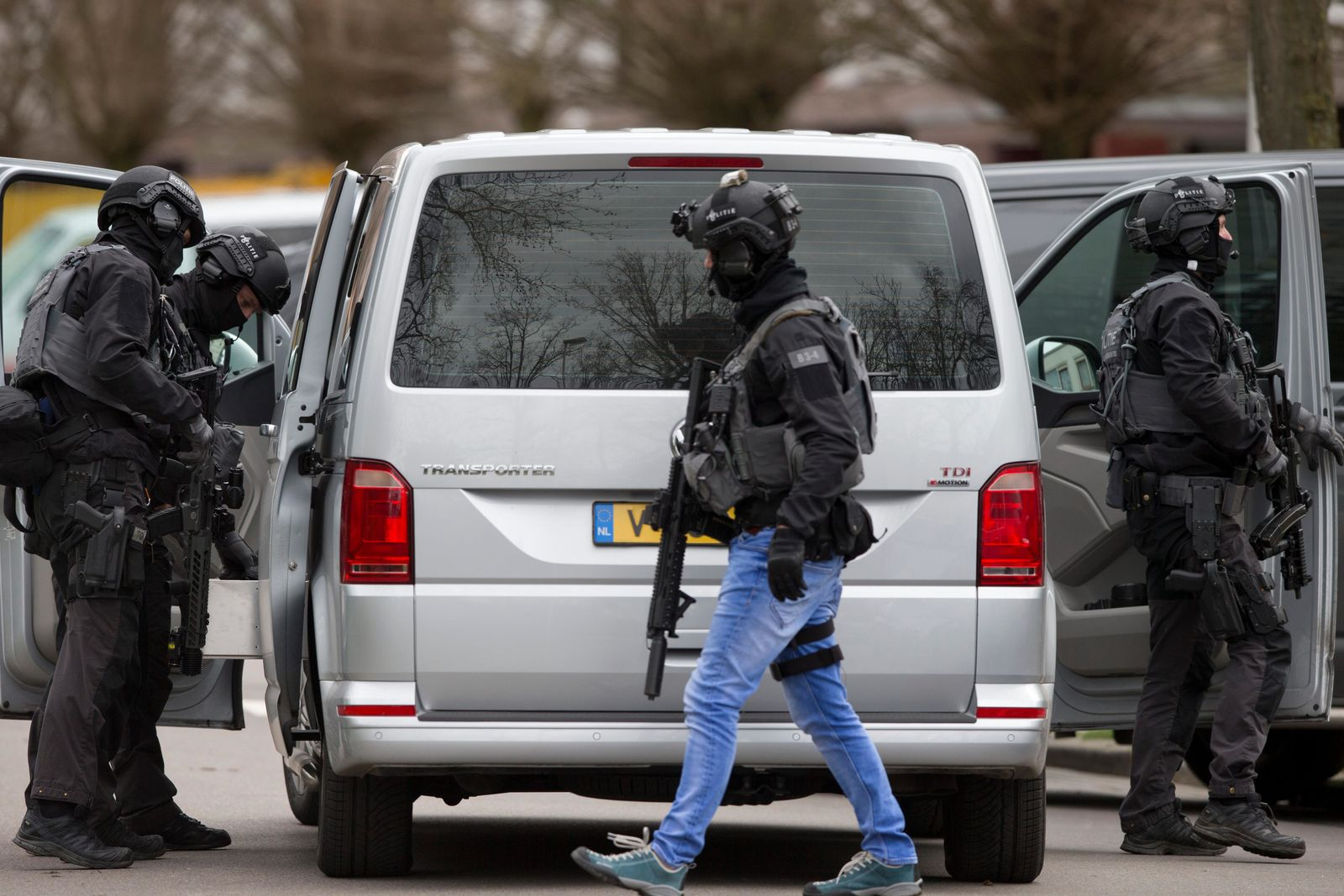 Dutch counter terrorism police prepare to enter a house after a shooting incident in Utrecht, Netherlands, Monday, March 18, 2019. (AP Photo/Peter Dejong)
