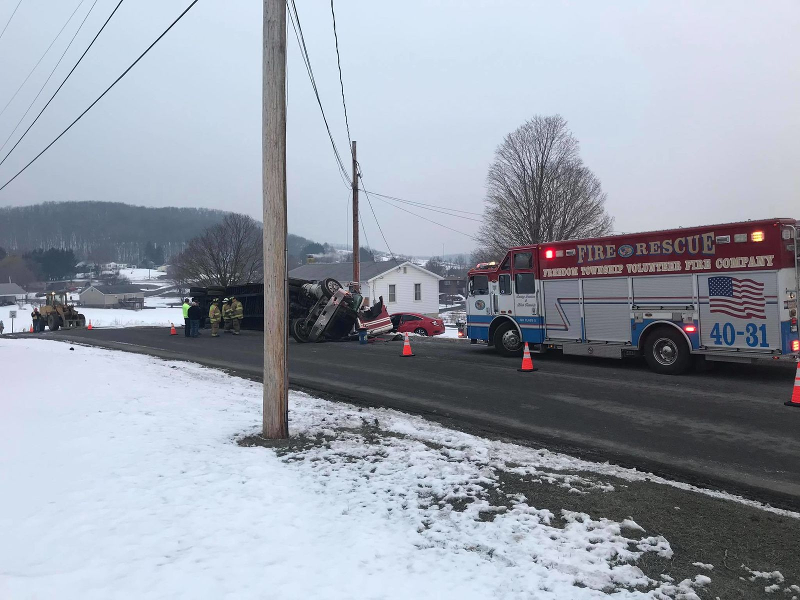 2 transported in car vs tractor-trailer crash. (Freedom Township Vol Fire Company)