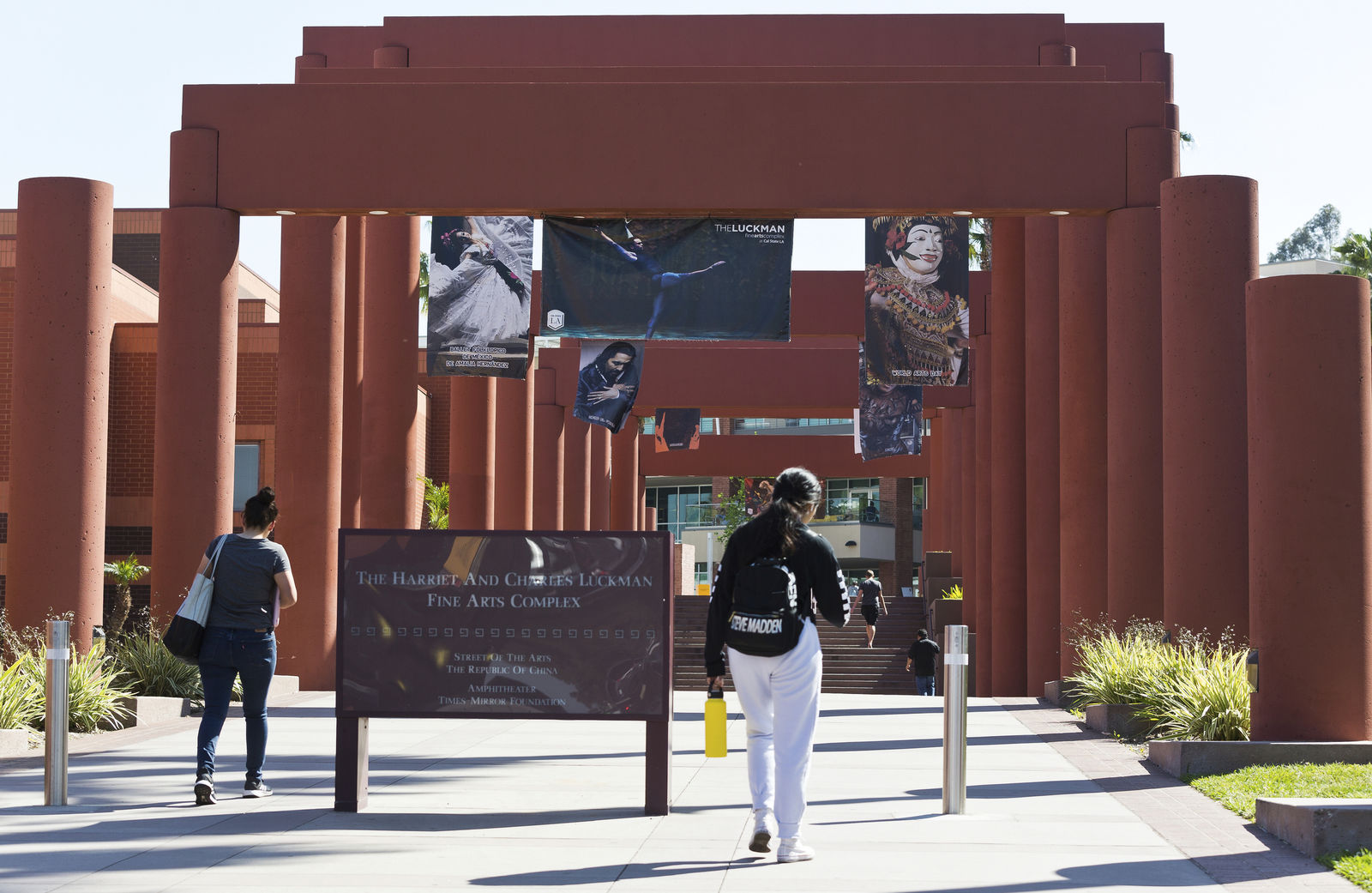 Students walk past the Harriet and Charles Luckman Fine Arts Complex at the The Cal State University, Los Angeles campus Thursday, April 25, 2019. (AP Photo/Damian Dovarganes)