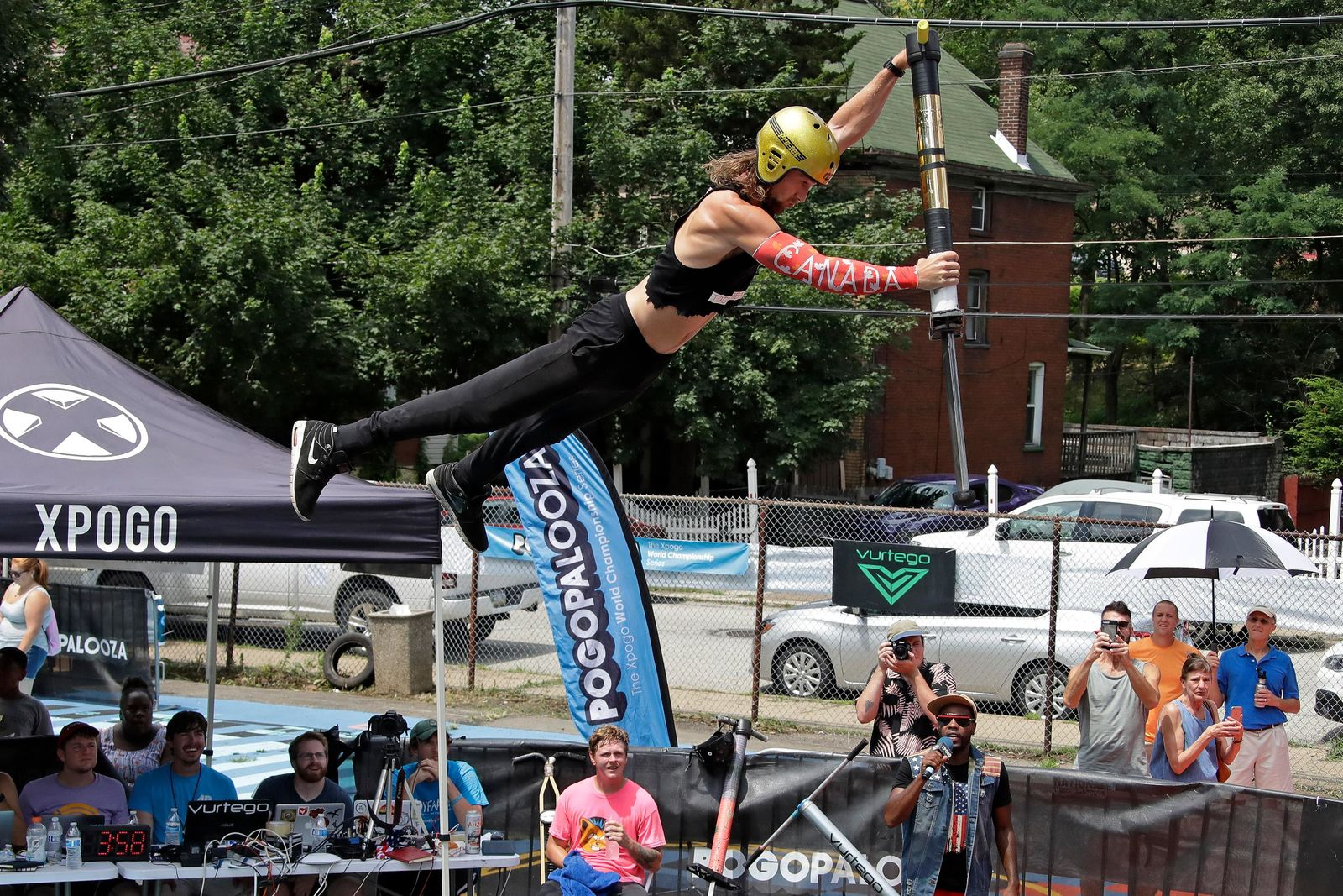 Harry White, of Orillia, Canada, performs in Pogopalooza, The World Championships of Pogo in Wilkinsburg, Pa., Saturday, July 20, 2019. White is the only Canadian in the two day competition. (AP Photo/Gene J. Puskar)