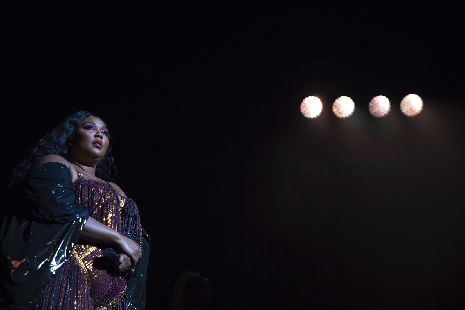 "FILE - This Sept. 25, 2019 file photo shows singer/songwriter Lizzo on stage at The Anthem in Washington.  There's a debate about the truth behind Lizzo's ""Truth Hurts."" The songwriting brothers Justin and Jeremiah Raisen, who worked on Lizzo's other song ""Healthy,"" claim say they deserve writing credit on ""Truth Hurts"" since the song borrows a line from a tune they co-wrote. (Photo by Brent N. Clarke/Invision/AP, File)"