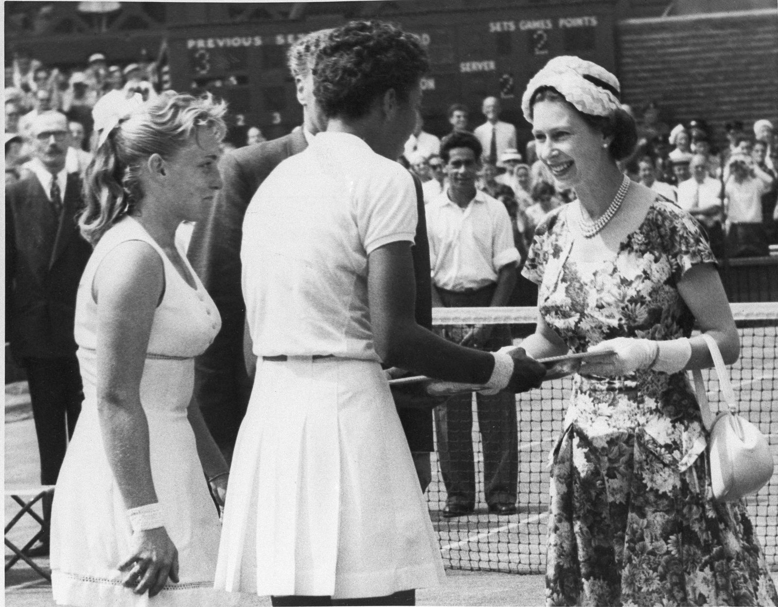 "FILE - In this July 6, 1957 file photo, Queen Elizabeth II, right, presents winners trophy to Althea Gibson who won the women's title in the All England Lawn Tennis Championship at Wimbledon. When the US Open begins this week, she will have a statue unveiled in her honor. Says tennis great Billie Jean King: ""She's our Jackie Robinson of tennis."" (AP Photo)"