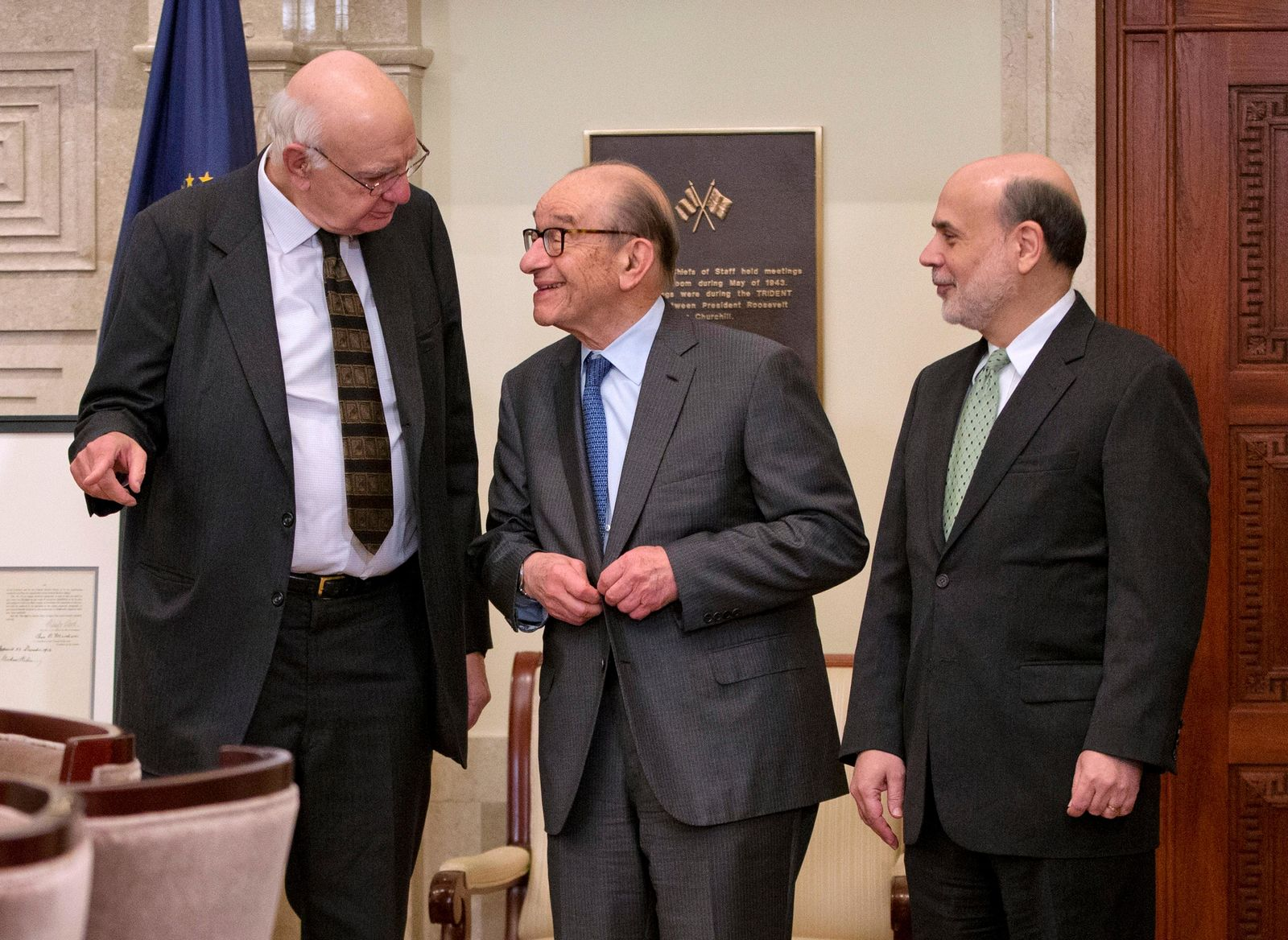 FILE - In this Dec. 16, 2013, file photo Federal Reserve Board Chairman Ben Bernanke, right, with former chairmen Paul Volcker, left, and Alan Greenspan, talk after participating in the ceremonial signing of a certificate commemorating the 100th anniversary of the signing of the Federal Reserve Act at the Federal Reserve Building in Washington. Volcker, the former Federal Reserve chairman died on Sunday, Dec. 8, 2019, according to his office, He was 92.{ }(AP Photo/Pablo Martinez Monsivais, File)