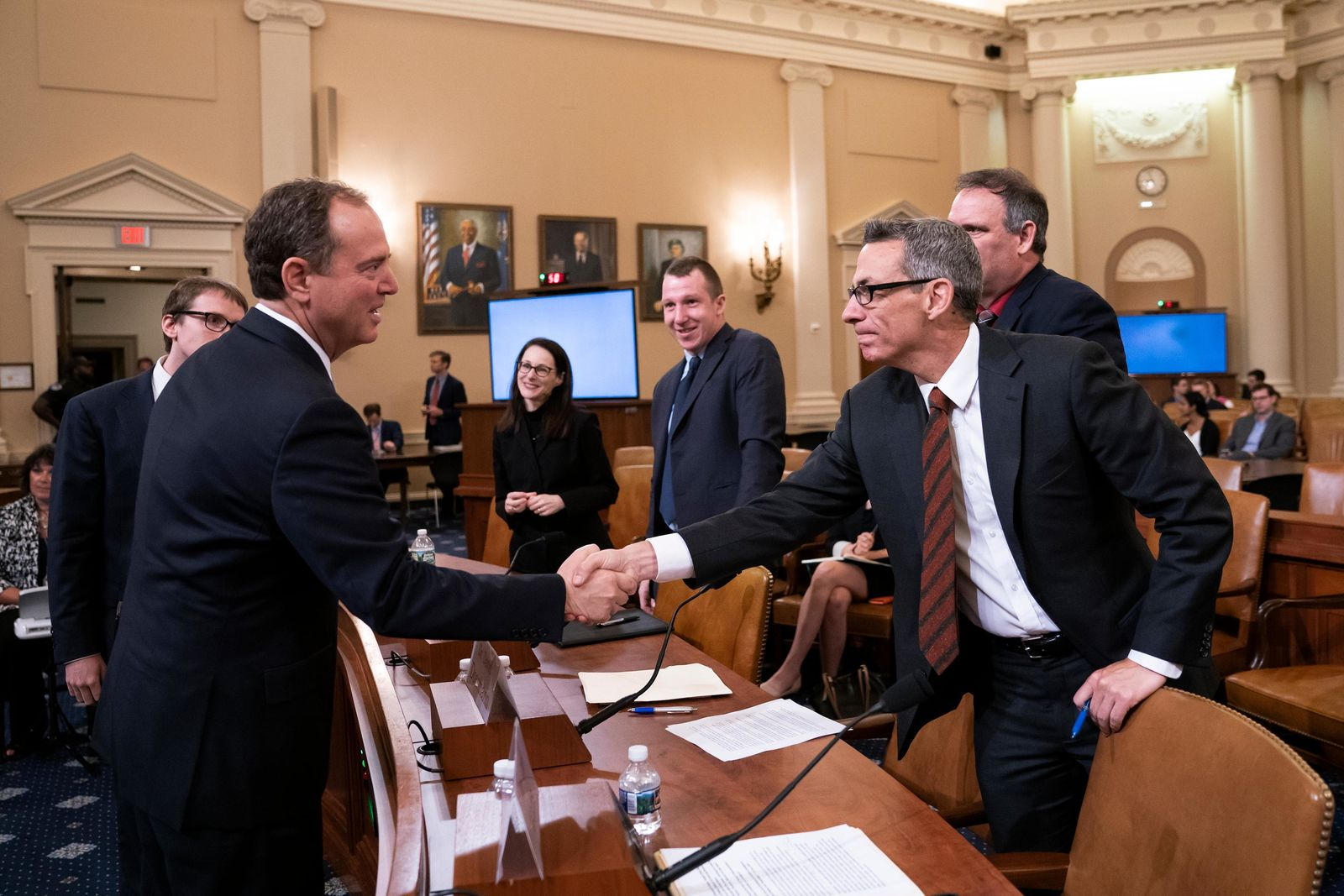 House Intelligence Committee Chairman Adam Schiff, D-Calif., left, greets witness Clint Watts, a cybersecurity and intelligence expert with the Foreign Policy Research Institute, at a hearing on politically motivated fake videos and manipulated media, on Capitol Hill in Washington, Thursday, June 13, 2019. (AP Photo/J. Scott Applewhite)