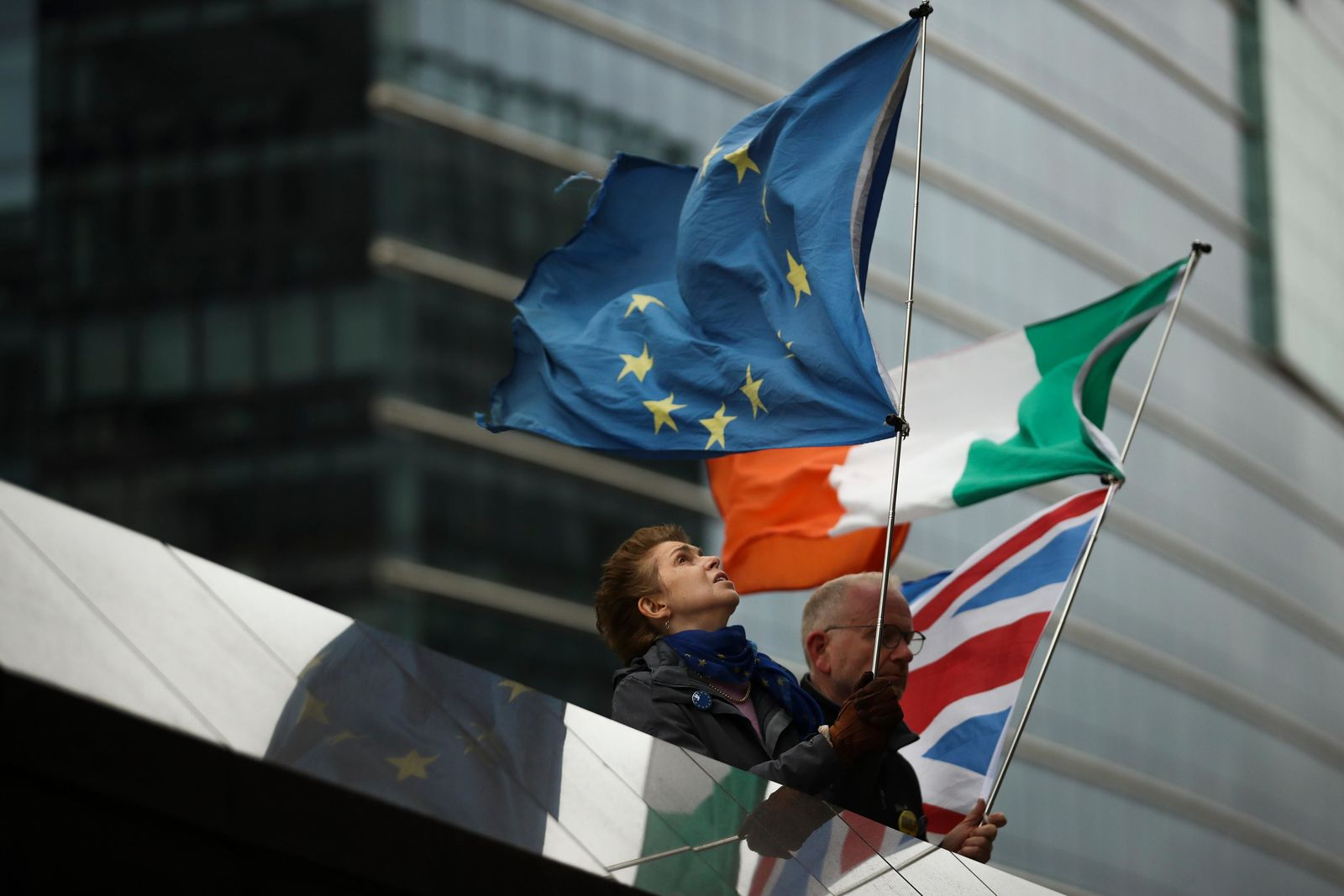 "Two anti-Brexit people hold EU, Ireland and Union Flags stand outside the European Commission in Brussels, Friday, Oct. 11, 2019. EU negotiator Michel Barnier says that he had a ""constructive meeting"" (AP Photo/Francisco Seco)"