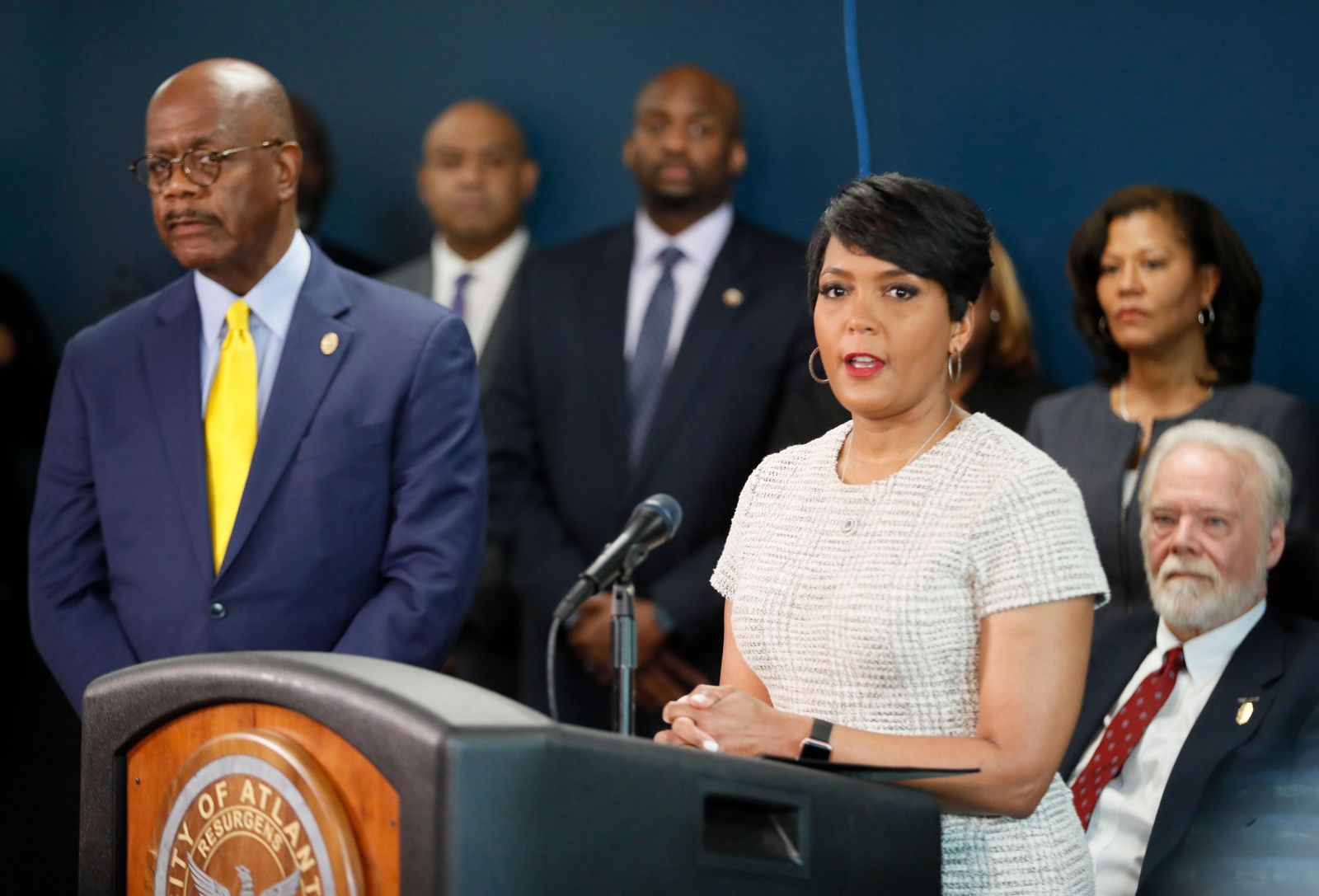 Atlanta Mayor Keisha Lance Bottoms, standing next to Fulton County District Attorney Paul Howard, announces Thursday, March 21, 2019  that officials will take a fresh look at the Atlanta child murders, a string of murders from 1979 to 1981 that terrorized the city's black community. (Bob Andres/Atlanta Journal-Constitution via AP)