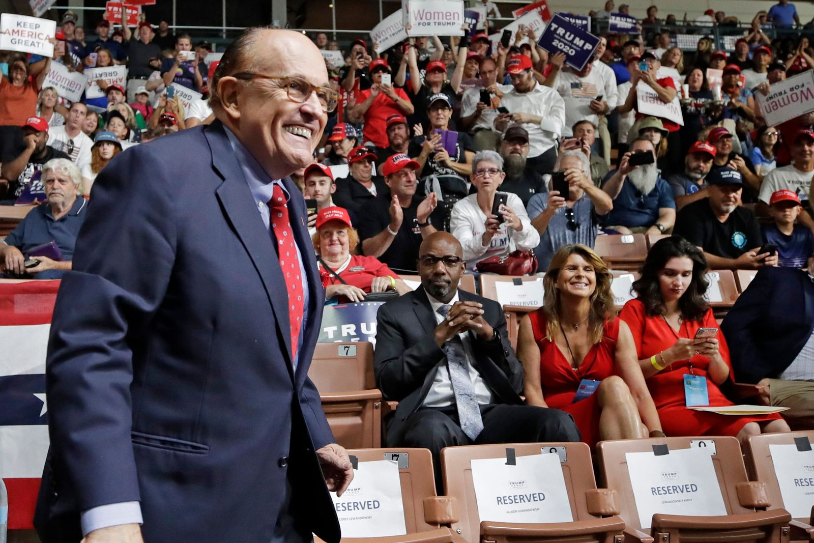 FILE - In this Aug. 15, 2019, file photo, former New York City Mayor Rudy Giuliani smiles as he arrives to President Donald Trump's campaign rally in Manchester, N.H.{ } (AP Photo/Elise Amendola, File)