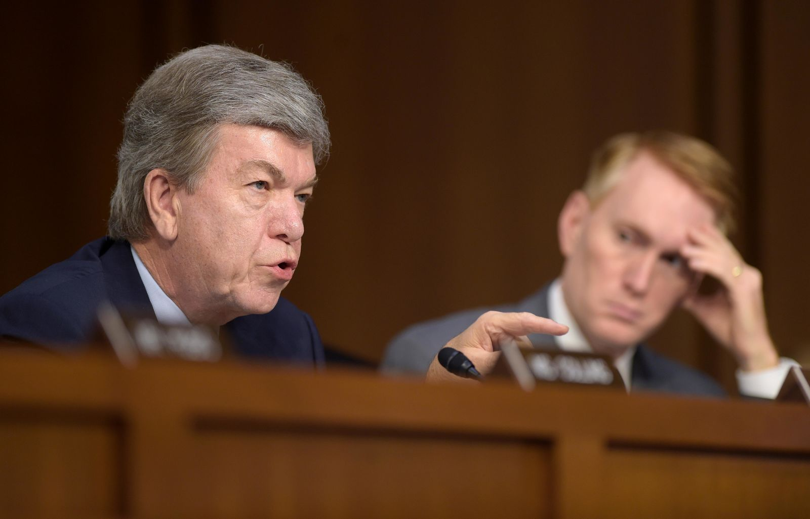 Sen. Roy Blunt, R-Mo., left, sitting next to Sen. James Lankford, R-Okla., right, asks a question during a Senate Intelligence Committee hearing about the Foreign Intelligence Surveillance Act, on Capitol Hill in Washington, Wednesday, June 7, 2017. (AP Photo/Susan Walsh)