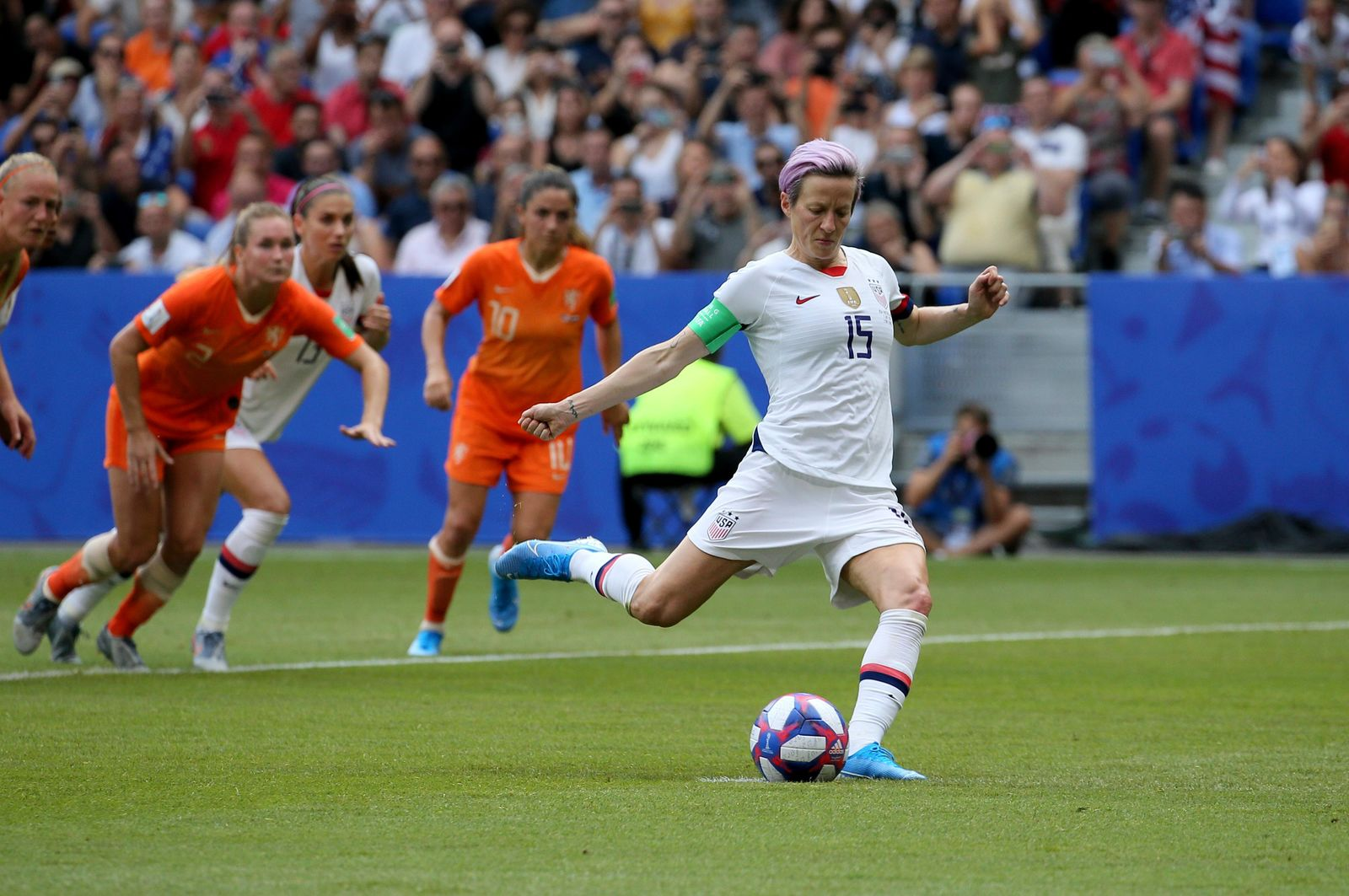 FILE - In this July 7, 2019, file photo, United States' Megan Rapinoe scores her side's opening goal from a penalty shot during the Women's World Cup final soccer match against The Netherlands at the Stade de Lyon in Decines, outside Lyon, France. (AP Photo/David Vincent, File)
