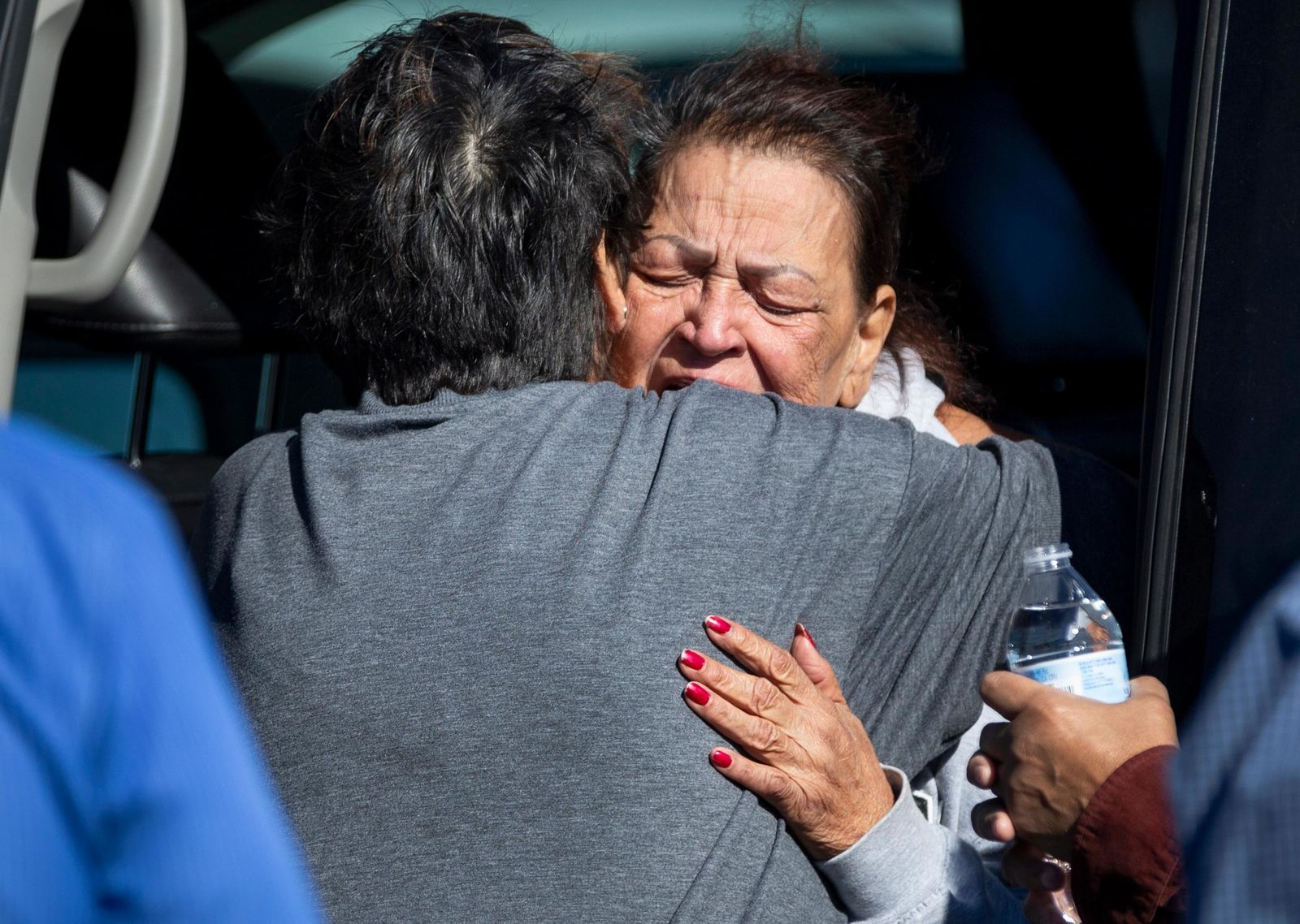 A family member reacts at the scene of a fatal shooting in the parking lot of a Walmart in Duncan, Okla., on Monday, Nov. 18, 2019. (Chris Landsberger/The Oklahoman via AP)