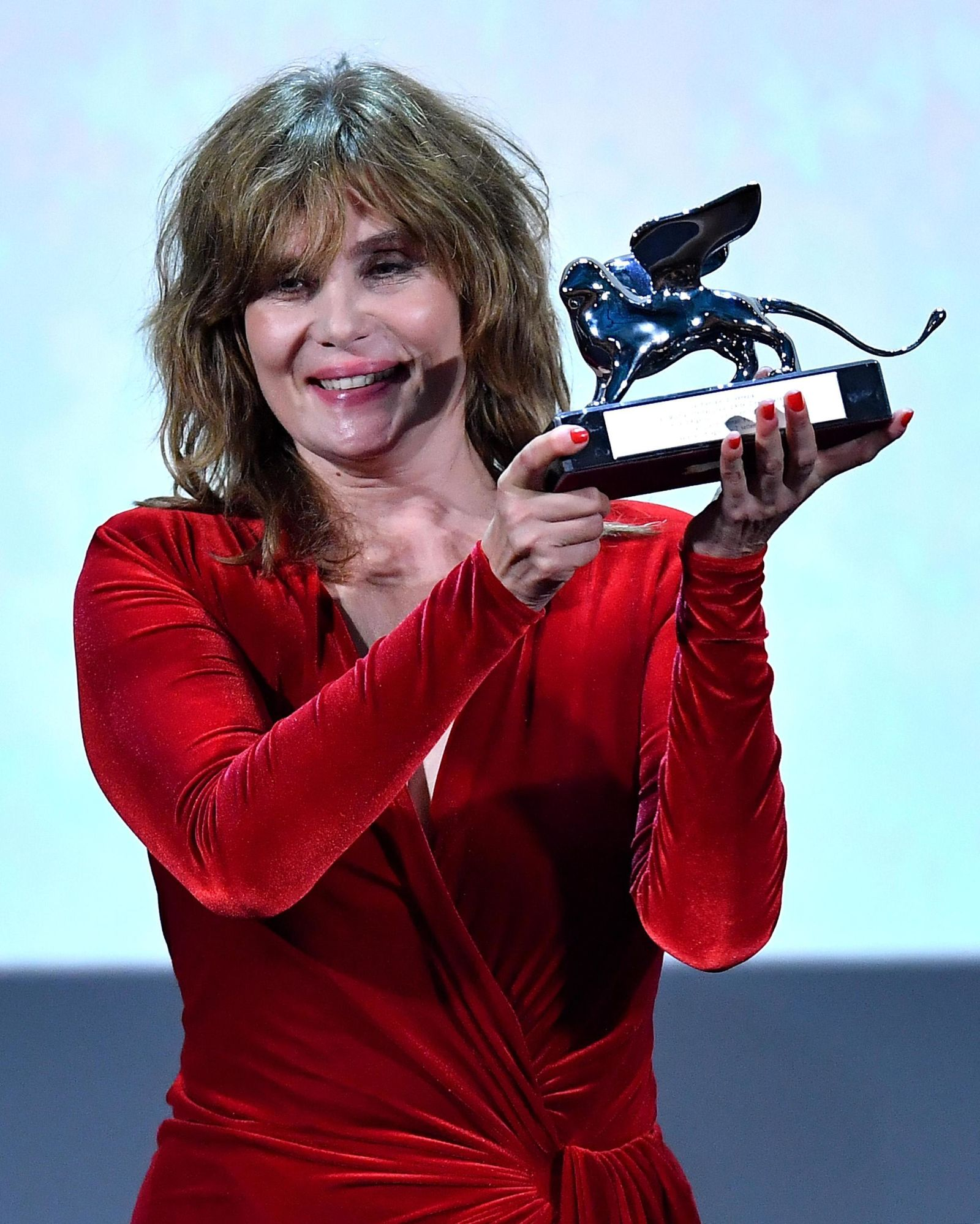 "French actress, model and singer, Emmanuelle Seigner receives the Grand Jury Prize for ""J'Accuse"" directed by Roman Polanski during the awarding ceremony of the 76th annual Venice International Film Festival in Venice, Italy, Saturday, Sept. 7, 2019. (Ettore Ferrari/ANSA via AP)"