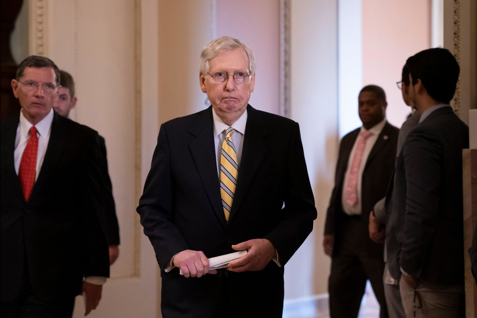 Senate Majority Leader Mitch McConnell, R-Ky., joined at left by Sen. John Barrasso, R-Wyo., arrives to speak to reporters during a news conference at the Capitol in Washington. (AP Photo/J. Scott Applewhite)
