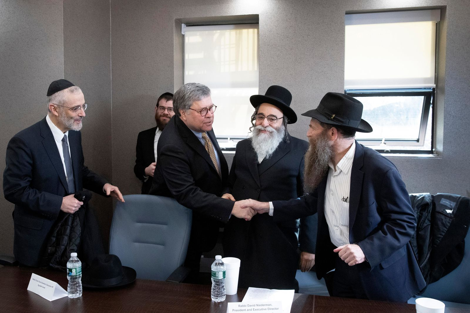 Attorney General William Barr, center, shakes hands with Rabbi Eli Cohen, right, at a meeting with Jewish leaders at the Boro Park Jewish Community Council, Tuesday, Jan. 28, 2020 in New York.{ } (AP Photo/Mark Lennihan)