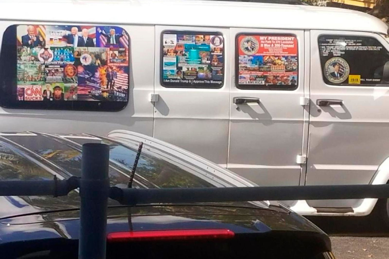 This Nov. 1, 2017, photo shows a van with windows covered with an assortment of stickers in Florida.{ } (Courtesy of Lesley Abravanel via AP)