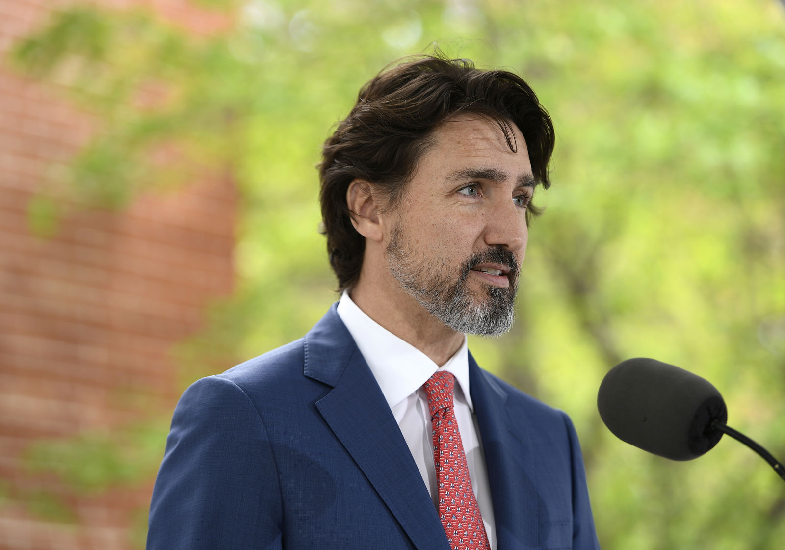 FILE - In this May 19, 2020, file photo, Canadian Prime Minister Justin Trudeau speaks during his daily news conference on the COVID-19 pandemic outside his residence at Rideau Cottage in Ottawa, Ontario. (Justin Tang/The Canadian Press via AP, File)