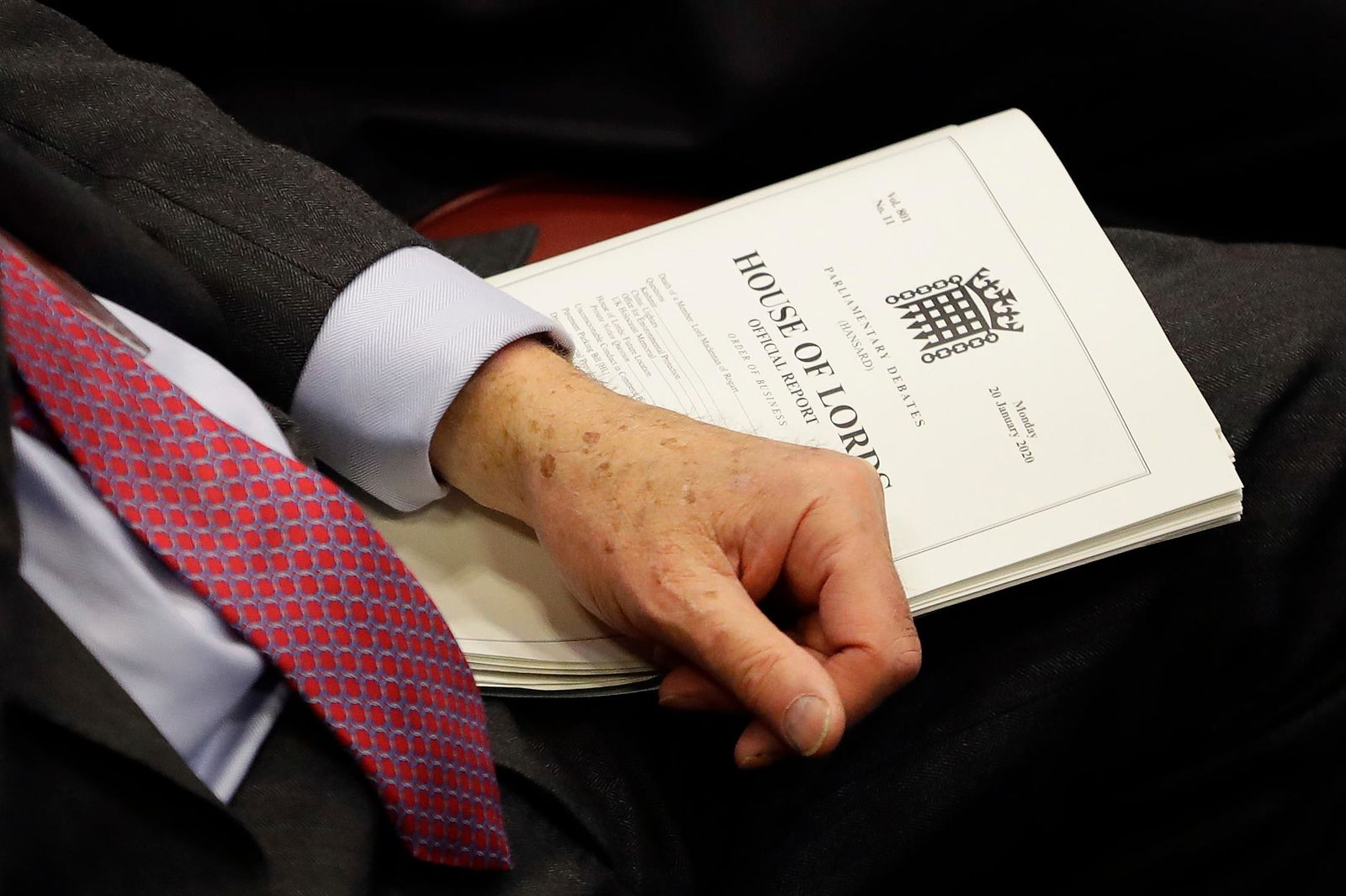 A member holds a document inside the House of Lords as the European Withdrawal Agreement Bill is debated in London, Tuesday, Jan. 21, 2020.{ } (AP Photo/Kirsty Wigglesworth, pool)