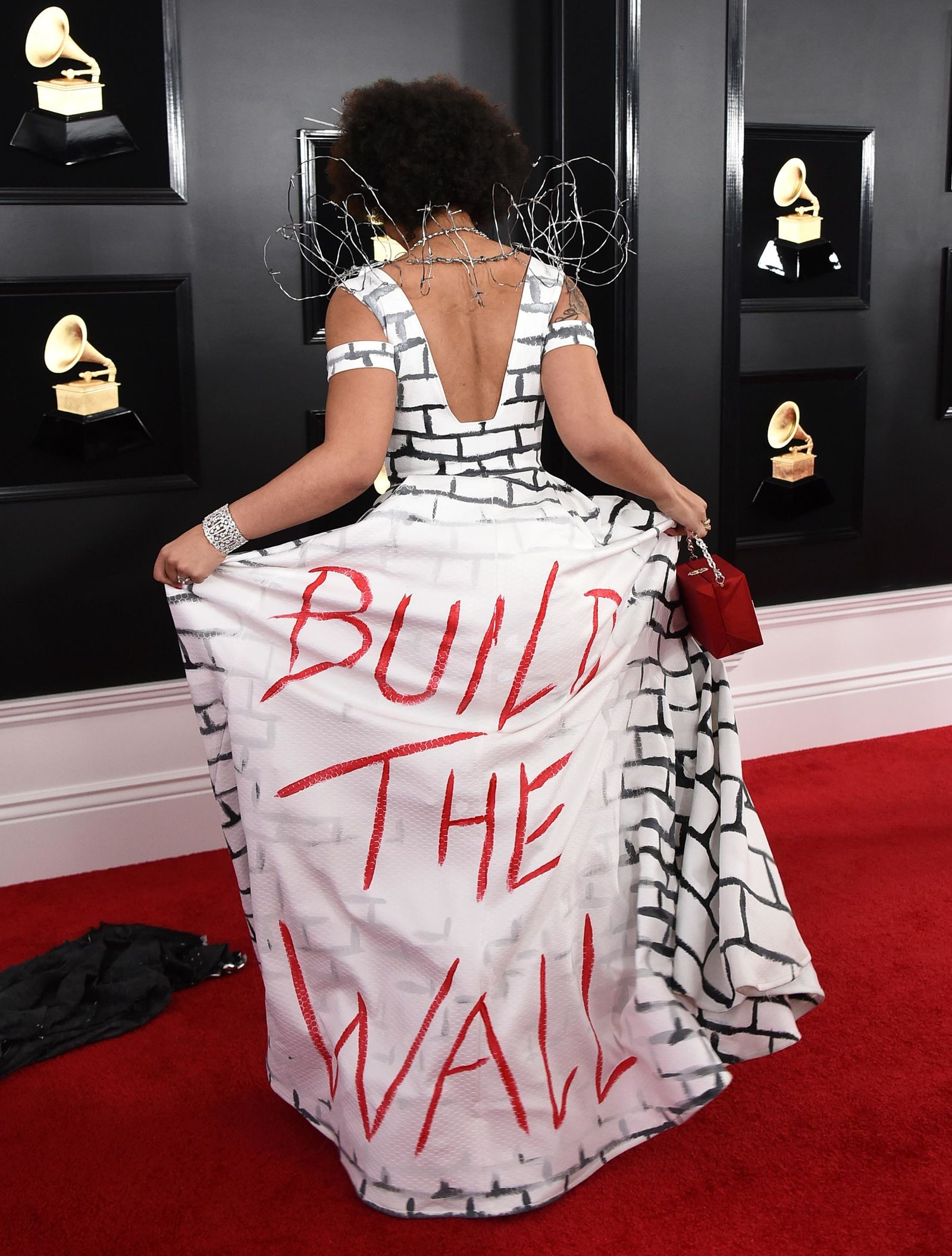 "Joy Villa arrives at the 61st annual Grammy Awards at the Staples Center wearing a dress that reads ""Build the Wall"" on Sunday, Feb. 10, 2019, in Los Angeles. (Photo by Jordan Strauss/Invision/AP)"