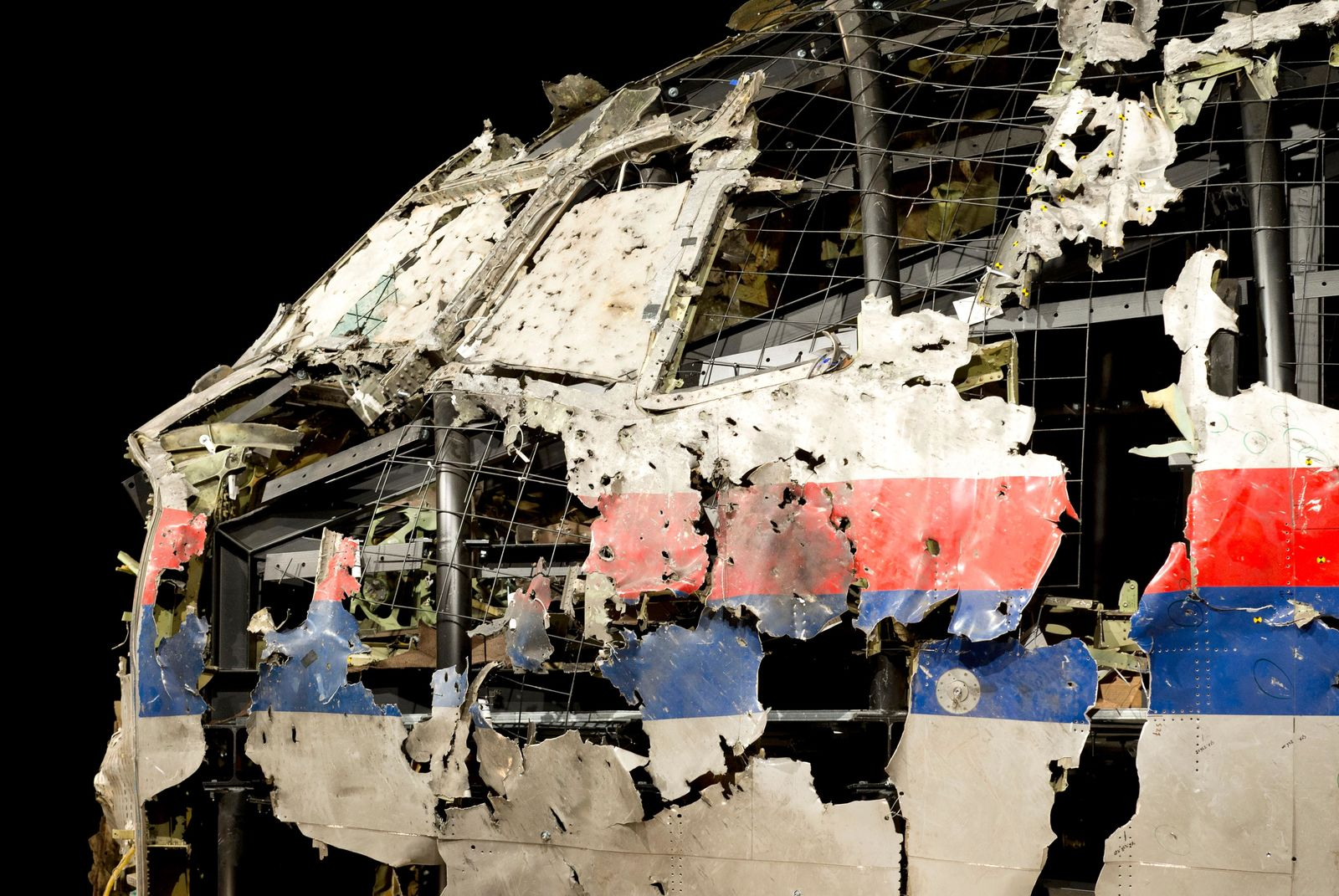 FIlE - In this file photo dated Tuesday, Oct. 13, 2015, the reconstructed cockpit of Malaysia Airlines Flight 17 plane is displayed before a news conference by the Dutch Safety Board in Gilze-Rijen, Netherlands. (AP Photo/Peter Dejong, FILE)