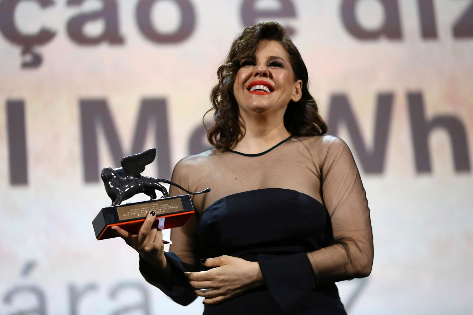 Actress Barbara Paz holds the Venice Classics Award for Best Documentary on Cinema for the film 'Babenco' at the closing ceremony of the 76th edition of the Venice Film Festival, Venice, Italy, Saturday, Sept. 7, 2019. (Photo by Joel C Ryan/Invision/AP)