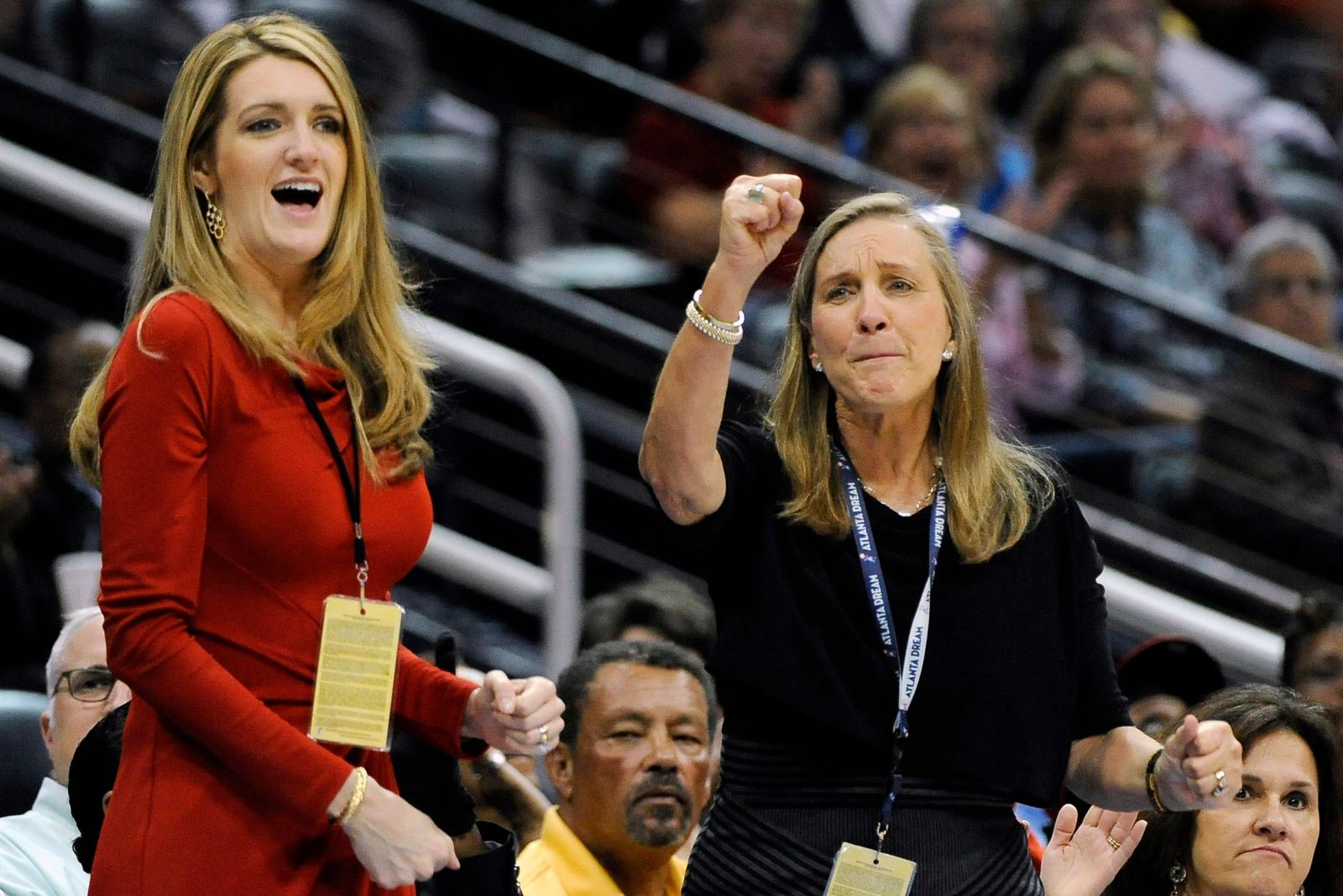 FILE-In this Tuesday, Sept. 6, 2011 file photo, Mary Brock, right, and Kelly Loeffler cheer from their courtside seats as the Atlanta Dream basketball team plays in the second half of their WNBA basketball game, in Atlanta. (AP Photo/David Tulis, File)