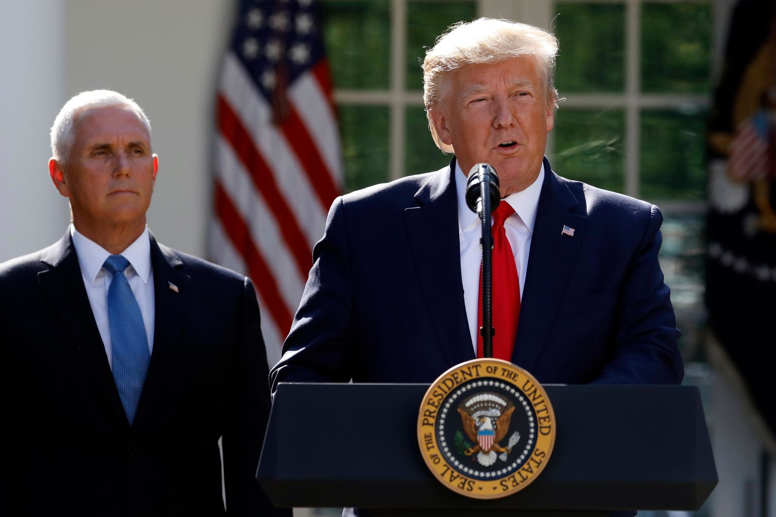 President Donald Trump says he is postponing his weekend trip to Poland and will send Vice President Mike Pence in his place during a event to announce the establishment of the U.S. Space Command in the Rose Garden of the White House in Washington. (AP Photo/Carolyn Kaster)