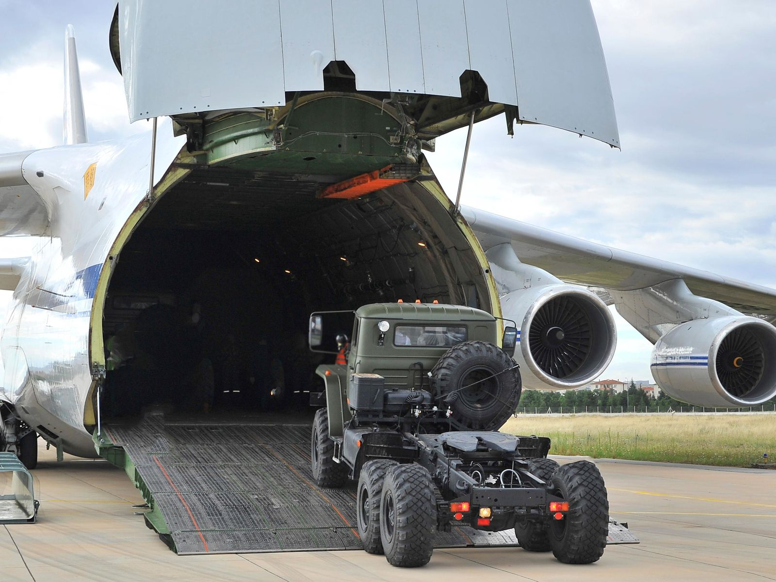 Military vehicles and equipment, parts of the S-400 air defense systems, are unloaded from a Russian transport aircraft, at Murted military airport in Ankara, Turkey, Friday, July 12, 2019.{ } (Turkish Defence Ministry via AP, Pool)