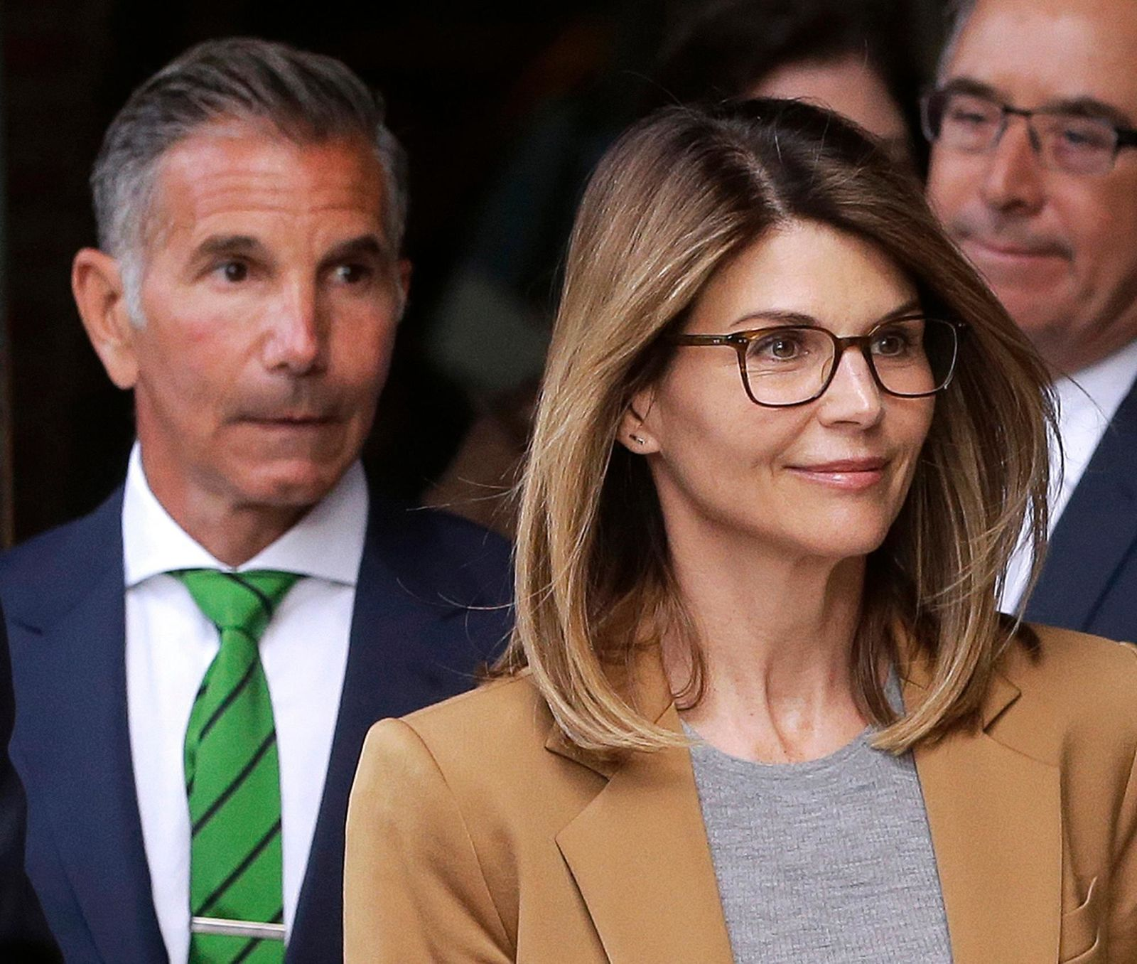 FILE - In this April 3, 2019, file photo, actress Lori Loughlin, front, and husband, clothing designer Mossimo Giannulli, left, leave federal court in Boston after facing charges in a nationwide college admissions bribery scandal. (AP Photo/Steven Senne, File)