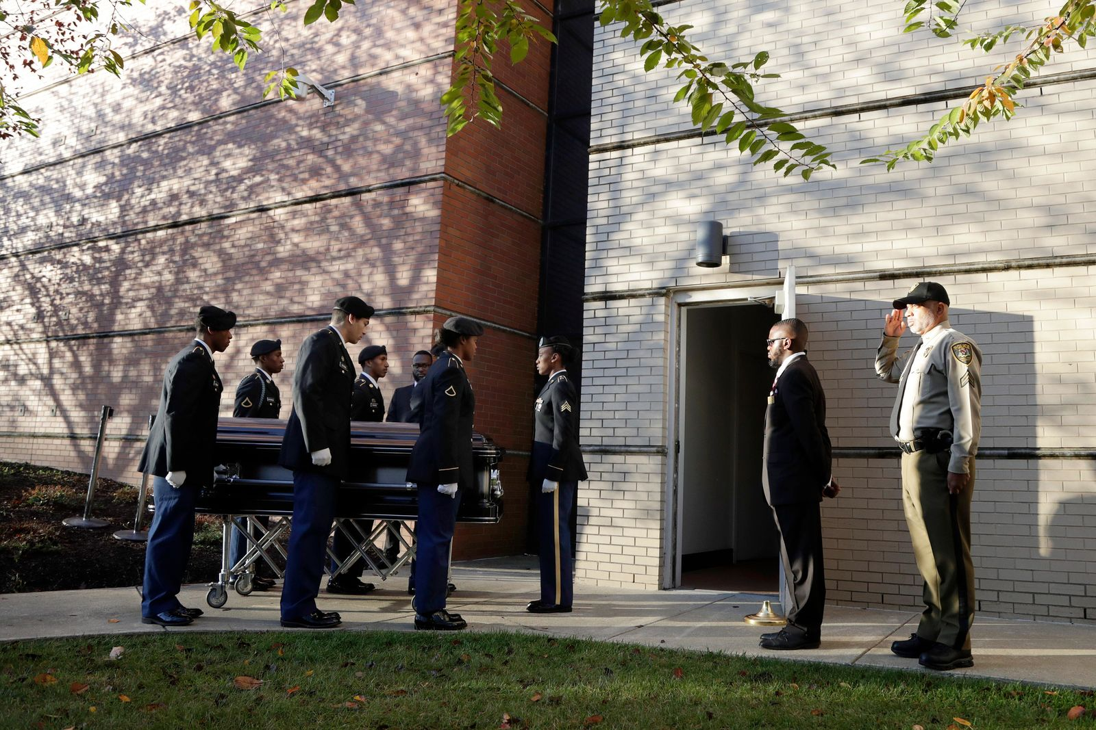 Pallbearers pause before entering the Murphy Fine Arts Center at Morgan State University ahead of a public viewing for U.S. Rep. Elijah Cummings, Wednesday, Oct. 23, 2019, in Baltimore. (AP Photo/Julio Cortez)
