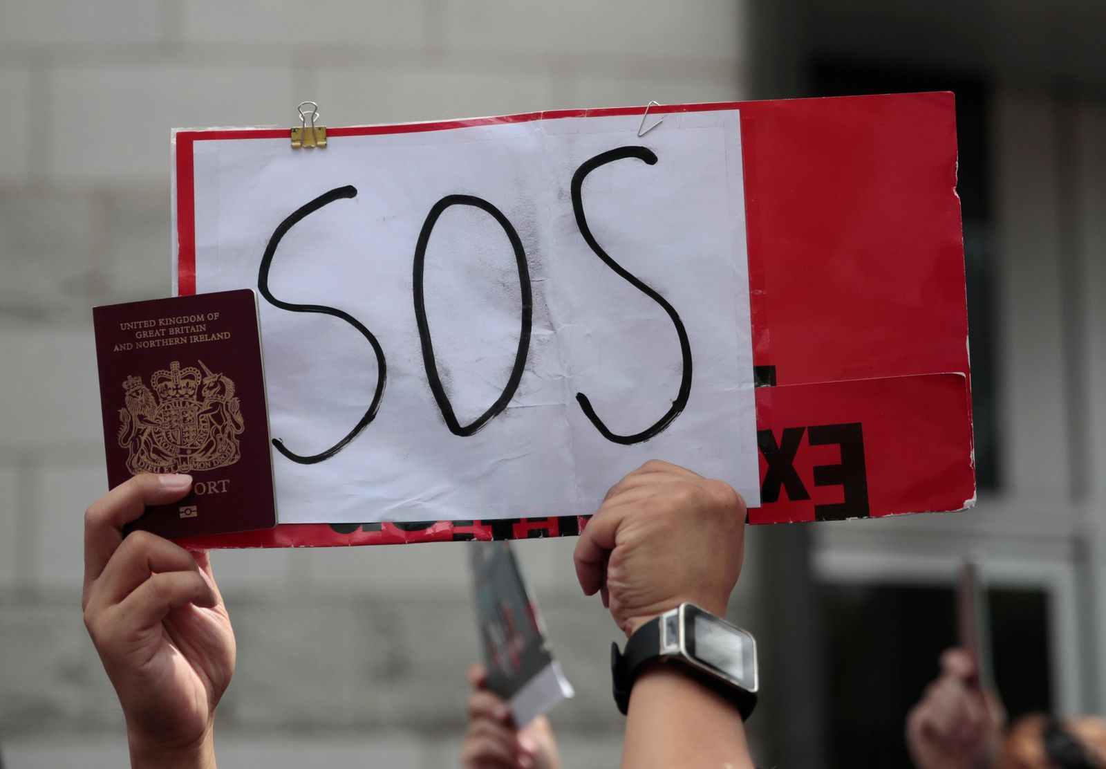 A protestor holds a placard and participates in a peaceful demonstration outside the British Consulate in Hong Kong, Sunday, Sept. 1, 2019. (AP Photo/Jae C. Hong)