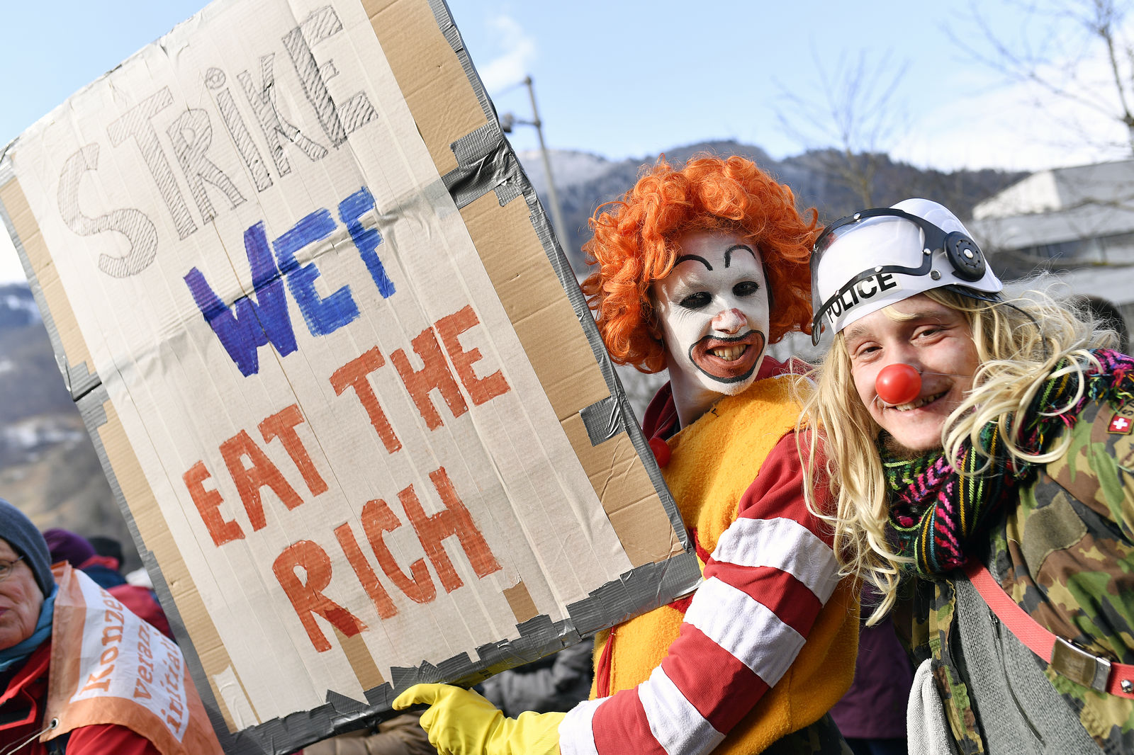 Participants of the climate protest march gather at the train station in Landquart, Switzerland, Sunday, Jan. 19, 2020. (Walter Bieri/Keystone via AP)