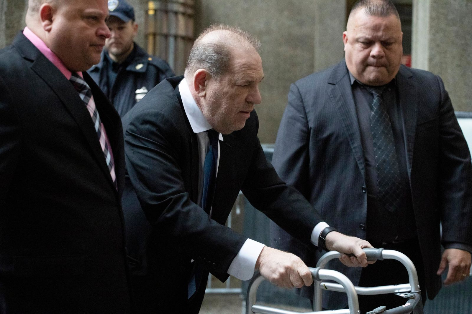 Harvey Weinstein, center, arrives for a court hearing, Wednesday, Dec. 11, 2019 in New York. (AP Photo/Mark Lennihan)