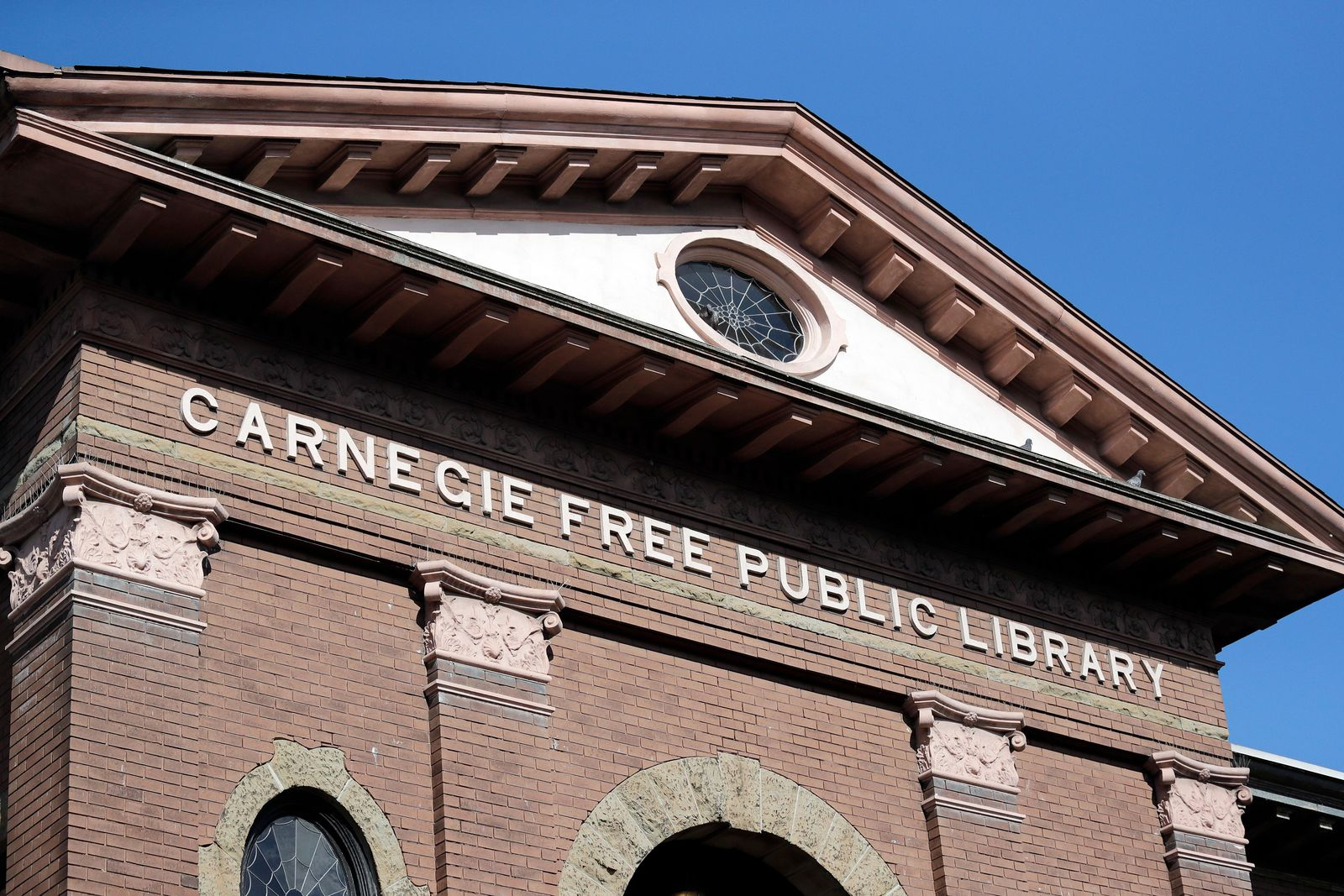 In this photo taken Wednesday, Oct. 10, 2018, the Carnegie name remains on what was the first major branch of the Seattle public library system, built with funds from philanthropist Andrew Carnegie, in Seattle. (AP Photo/Elaine Thompson)