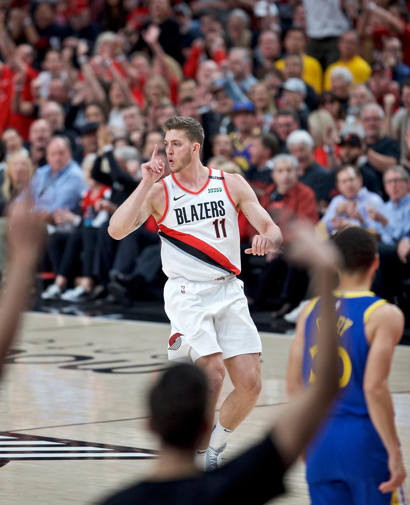 Portland Trail Blazers forward Meyers Leonard reacts after making a three-point basket against the Golden State Warriors during the first half of Game 3 of the NBA basketball playoffs Western Conference finals Saturday, May 18, 2019, in Portland, Ore. (AP Photo/Craig Mitchelldyer)