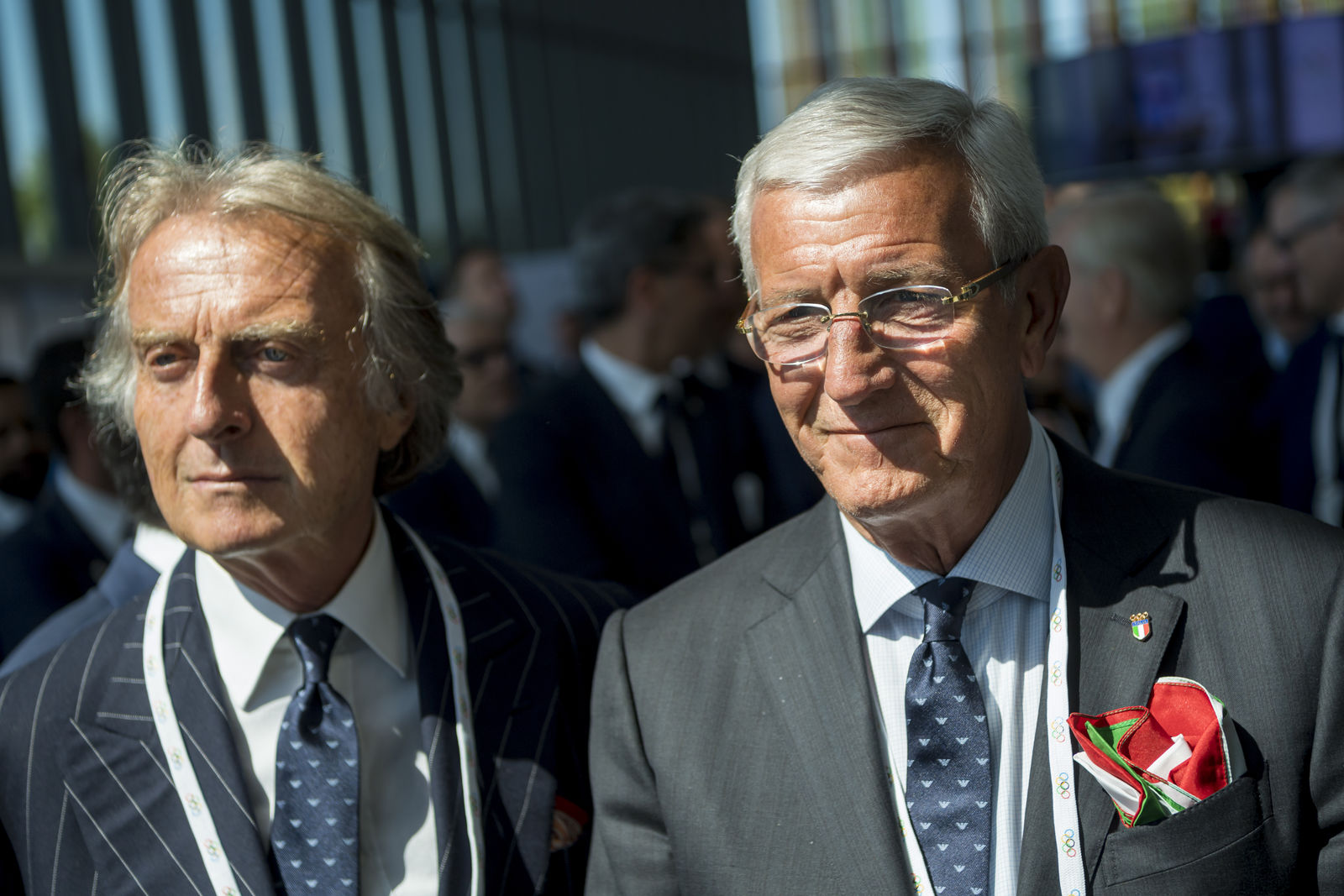 Alitalia President Luca cordero di Montezemolo, left, and former Italian soccer player and coach Marcello Lippi, right, arrive during the first day of the 134th Session of the International Olympic Committee (IOC), at the SwissTech Convention Centre, in Lausanne, Switzerland, Monday, June 24, 2019. (Jean-Christophe Bott/Keystone via AP)