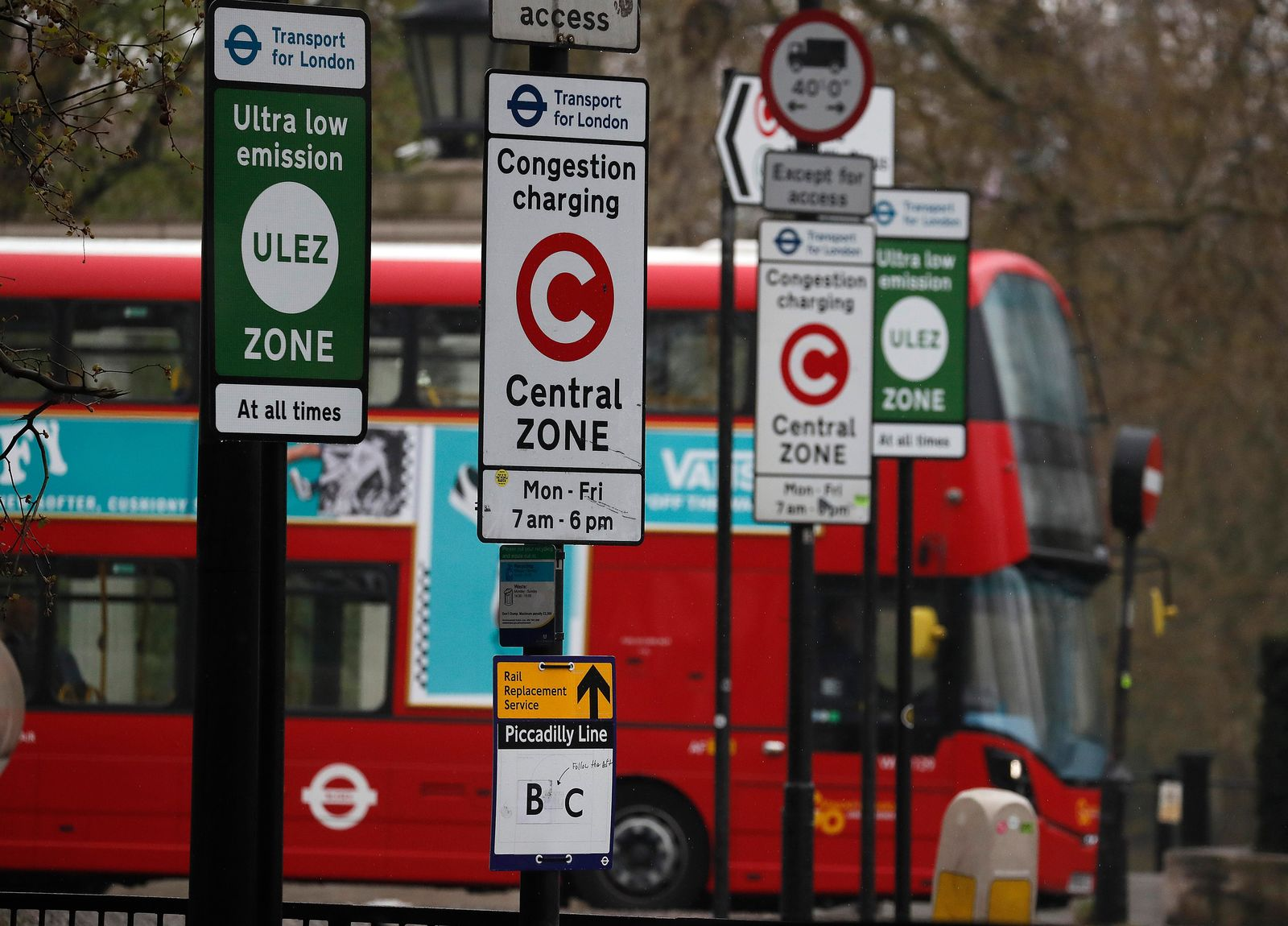 A London bus enters the new Ultra Low Emission Zone that has come into force Monday, in London, Monday, April 8, 2019, one of the world's first emission charge for cars. Drivers of older and more polluting cars face paying a new £12.50 fee adding to the Congestion Charge to enter the centre of the capital. (AP Photo/Frank Augstein)