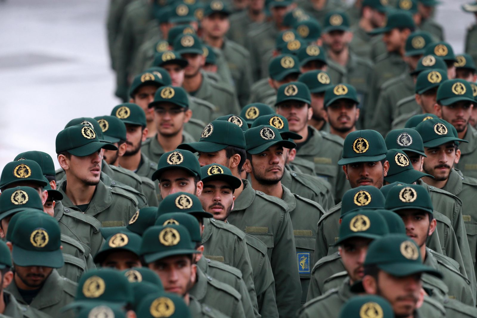 "FILE - In this Feb, 11, 2019 file photo, Iranian Revolutionary Guard members arrive for a ceremony celebrating the 40th anniversary of the Islamic Revolution, at the Azadi, or Freedom, Square, in Tehran, Iran.  President Donald Trump's administration is preparing to designate Iran's Revolutionary Guard as a ""foreign terrorist organization."" It's an unprecedented move that could have widespread implications for U.S. personnel and policy in the Mideast and elsewhere. U.S. officials say an announcement is expected Monday. (AP Photo/Vahid Salemi)"