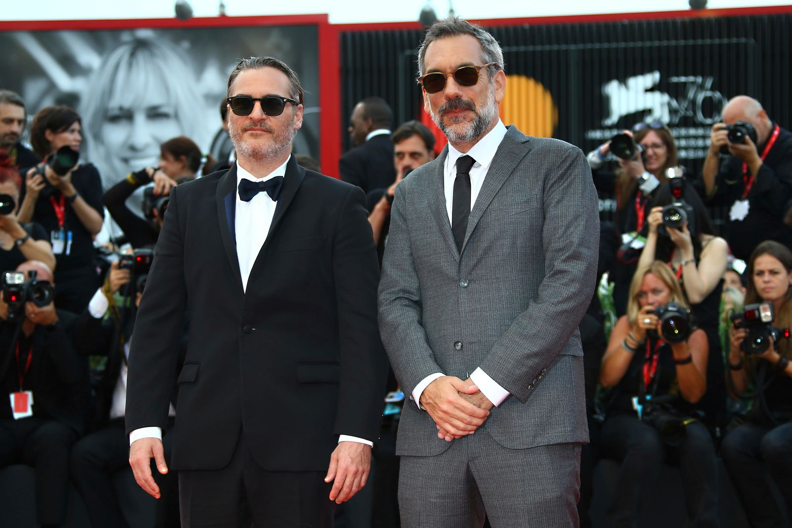 Actor Joaquin Phoenix, left, and Todd Phillips pose for photographers upon arrival at closing ceremony of the 76th edition of the Venice Film Festival, Venice, Italy, Saturday, Sept. 7, 2019. (Photo by Joel C Ryan/Invision/AP)