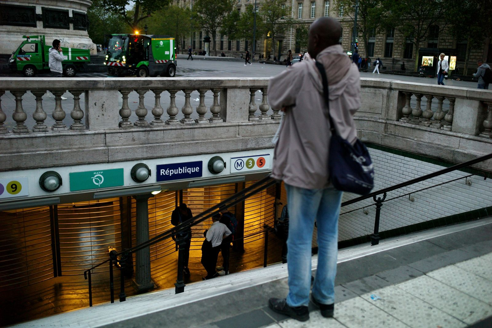 A man stands in front of the closed gate of the Republique square metro station, in Paris, Friday, Sept. 13, 2019. Paris metro warns over major strike, transport chaos Friday. (AP Photo/Thibault Camus)