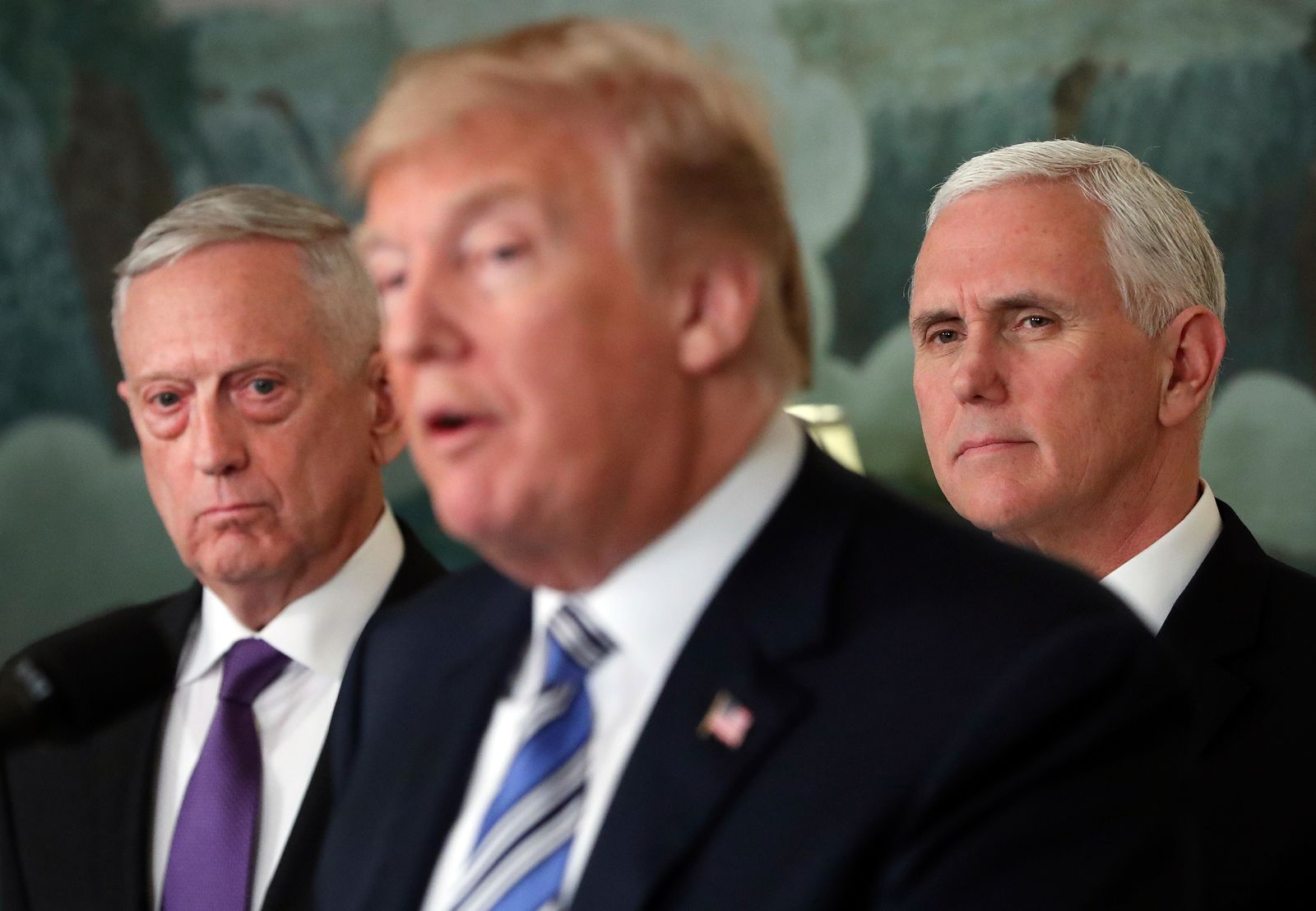 FILE - In this March 23, 2018 file photo, Defense Secretary Jim Mattis, left, and Vice President Mike Pence, right, listen to President Donald Trump, center, speaks in the Diplomatic Room of the White House in Washington.{ } (AP Photo/Pablo Martinez Monsivais)