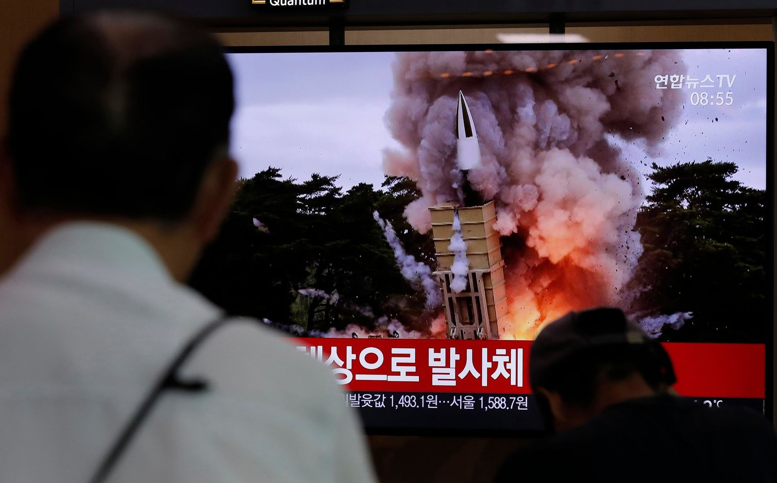"People watch a TV news program reporting North Korea's firing projectiles with a file image at the Seoul Railway Station in Seoul, South Korea, Saturday, Aug. 24, 2019. North Korea fired two suspected short-range ballistic missiles off its east coast on Saturday in the seventh consecutive week of weapons tests, South Korea's military said, a day after it threatened to remain America's biggest threat in protest of U.S.-led sanctions on the country. The part of Korean letters read: ""Projectiles."" (AP Photo/Lee Jin-man)"