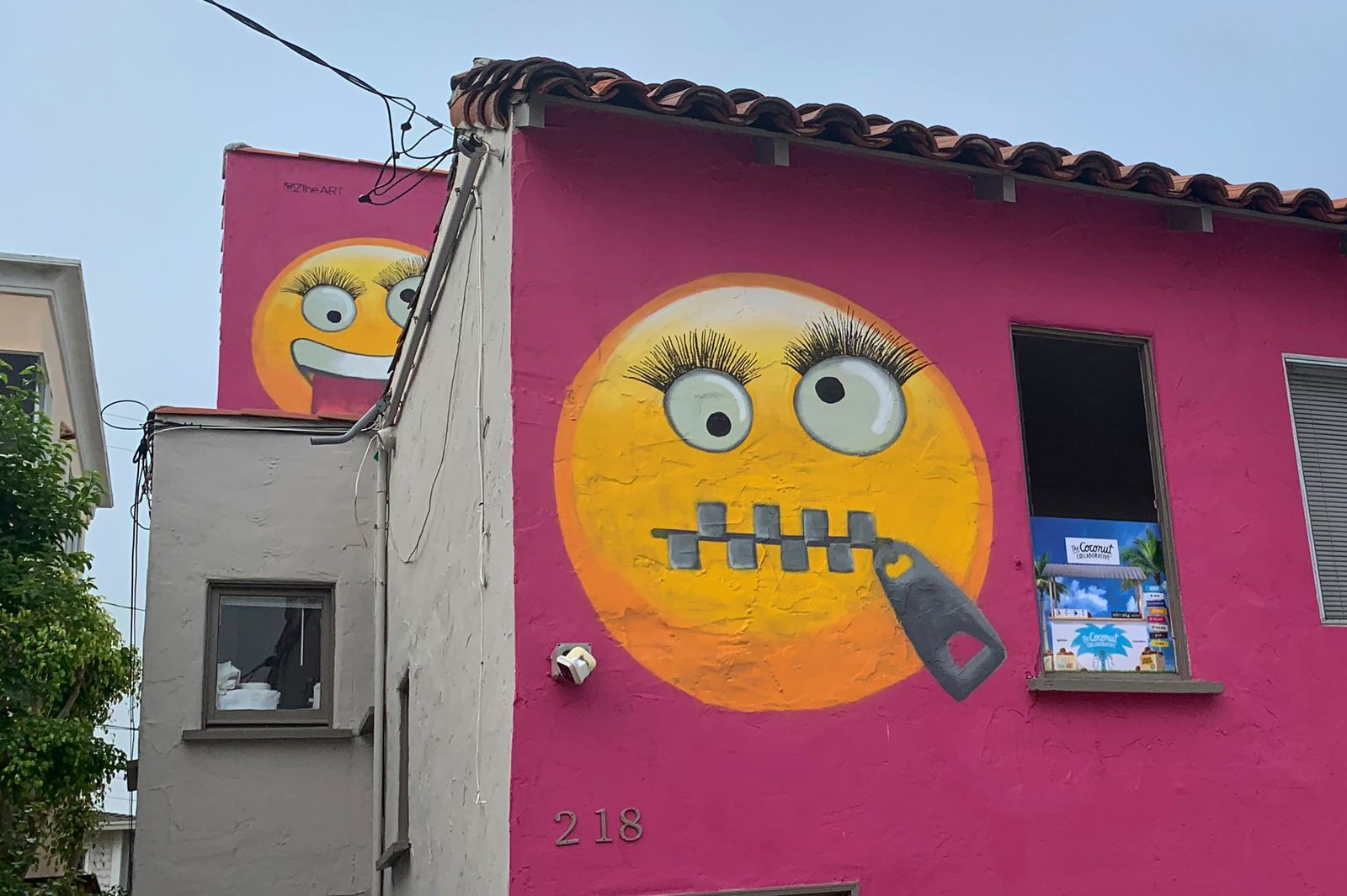 Painted emoji are seen on a house in Manhattan Beach, Calif. on Wednesday, Aug. 7, 2019.{ } (AP Photo/Natalie Rice)